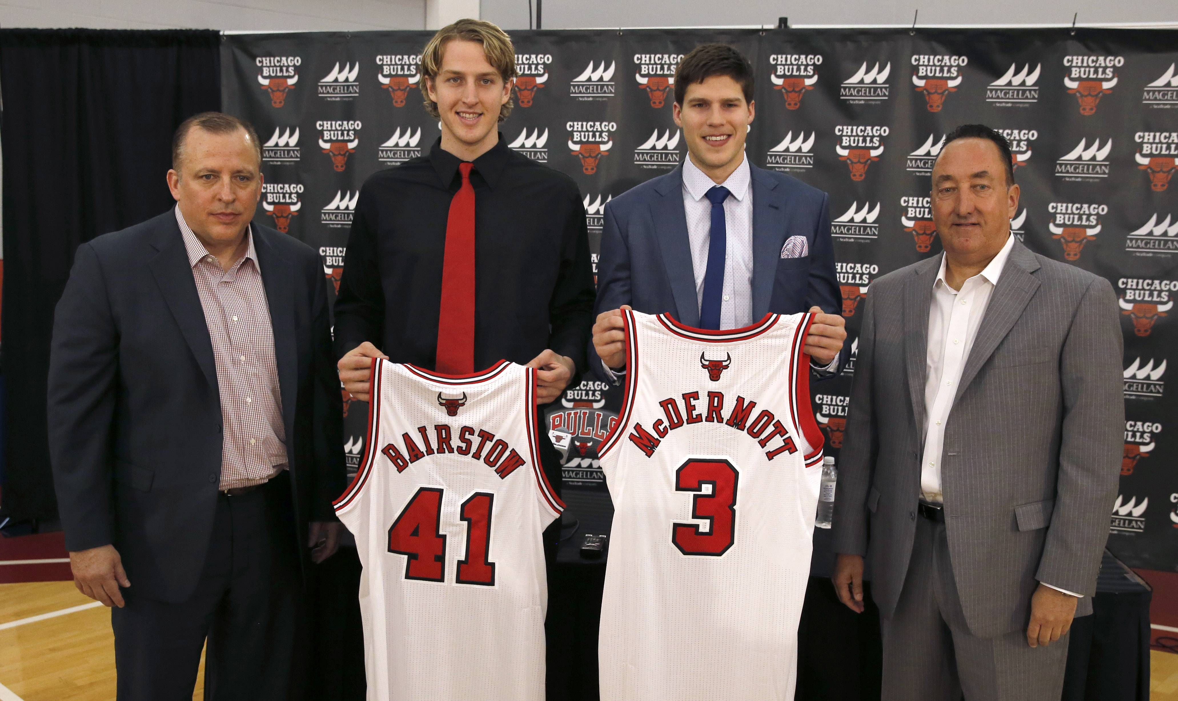 Bulls coach Tom Thibodeau, far left, and general manager Gar Forman, far right, stand with first- and second-round draft picks Cameron Bairstow (41) and Doug McDermott during a news conference Monday.
