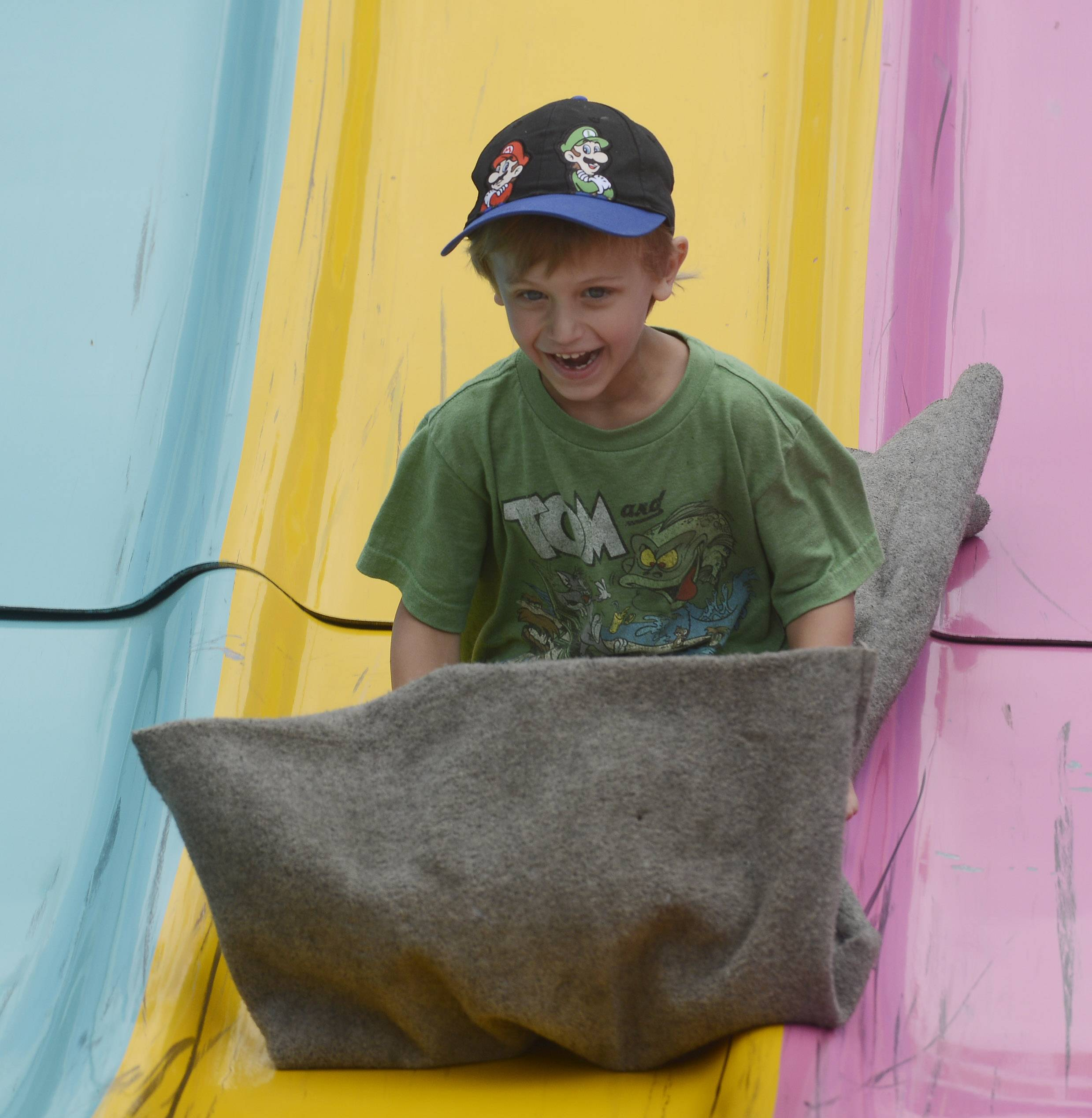 Evan DeNardis, of Mount Prospect, takes a ride on the Fun Slide during last year's festival.
