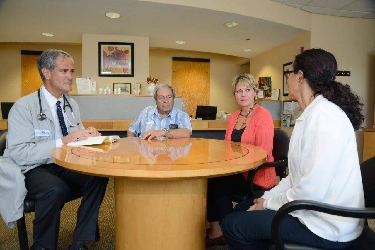 Dr. Evan Lipkis of Glenview meets with a patient and family to discuss end-of-life issues.