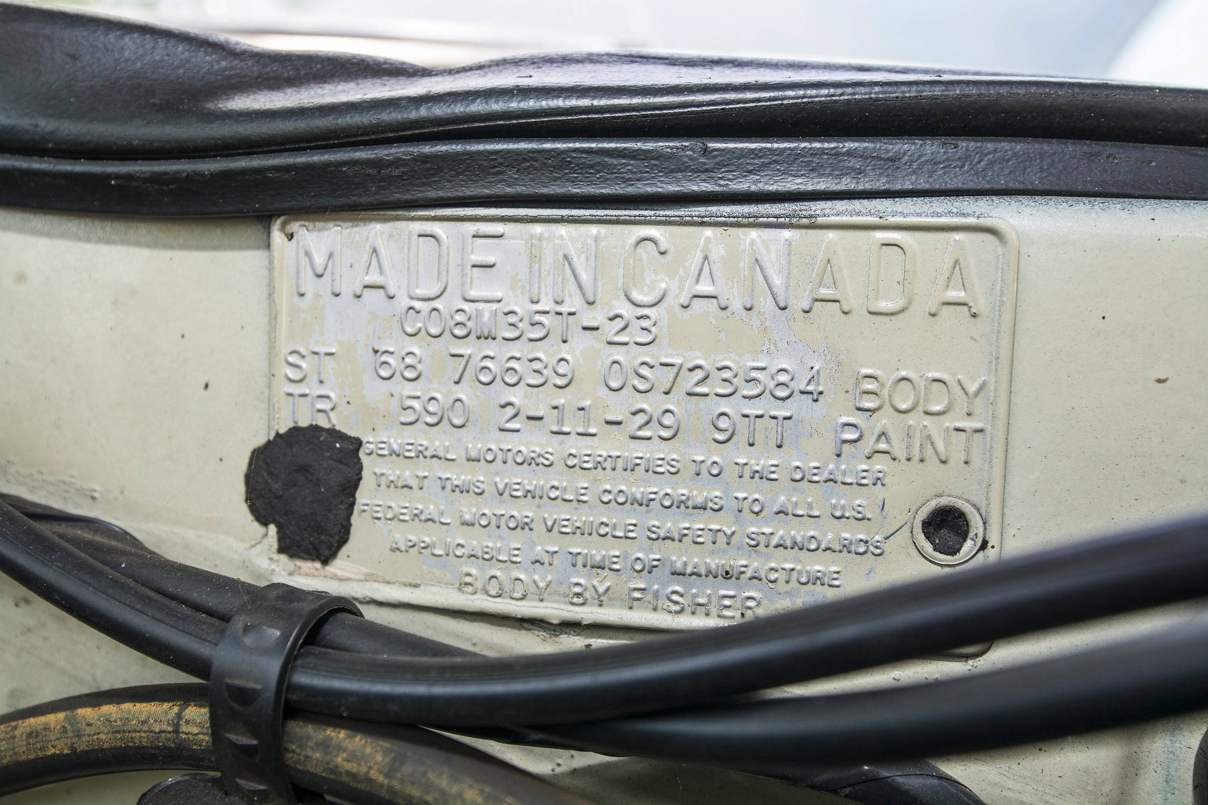 This plaque on the engine compartment firewall gives evidence of the car's origin.
