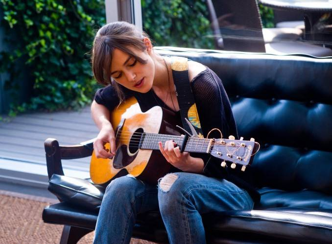 "Greta (Keira Knightley) preps for her musical break in John Carney's street musical ""Begin Again."""