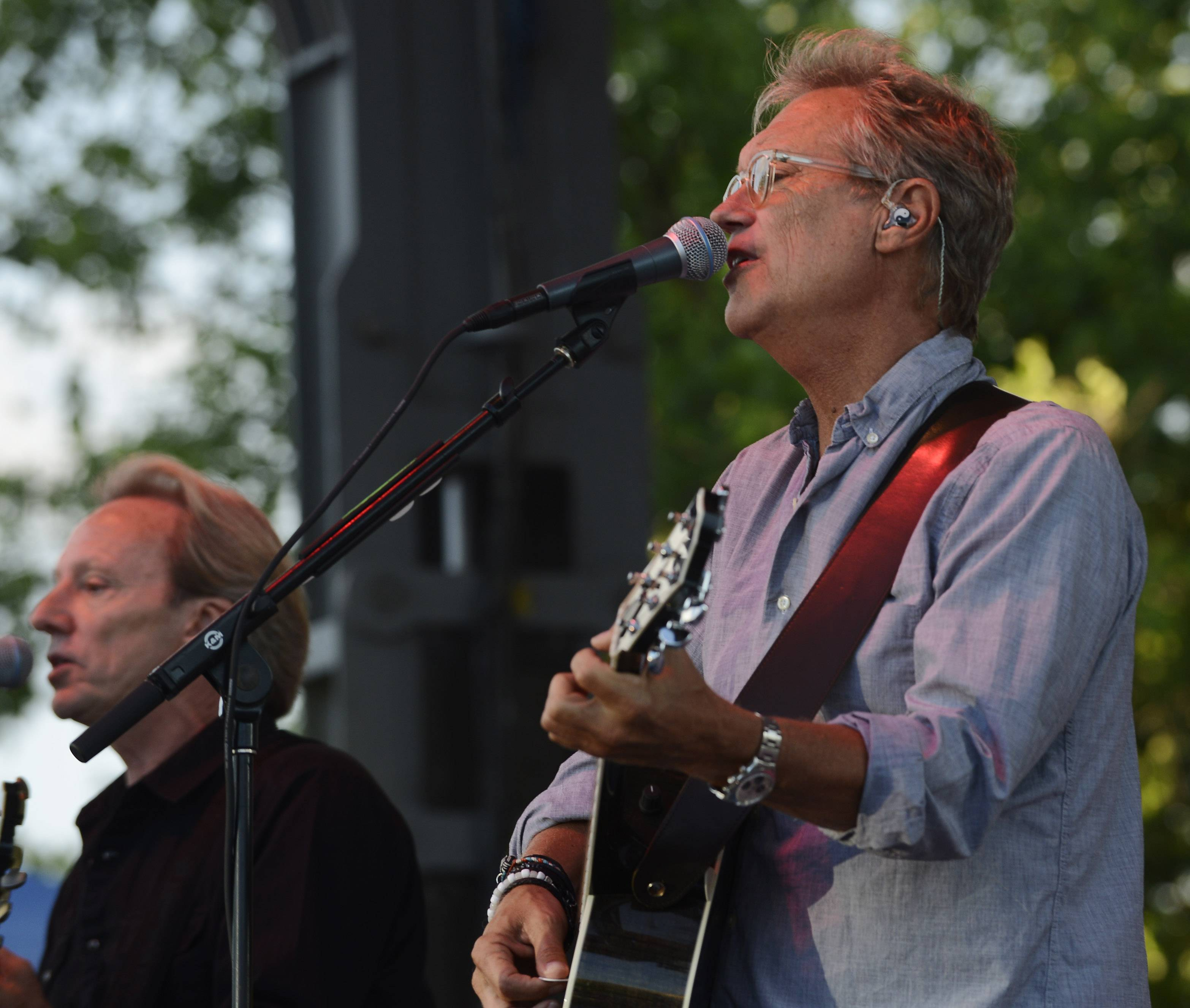 "Gerry Beckley, right, and Dewey Bunnell sing as the band ""America"" performs during the Mid-Summer Classics Concert Series in Elk Grove Village Tuesday."