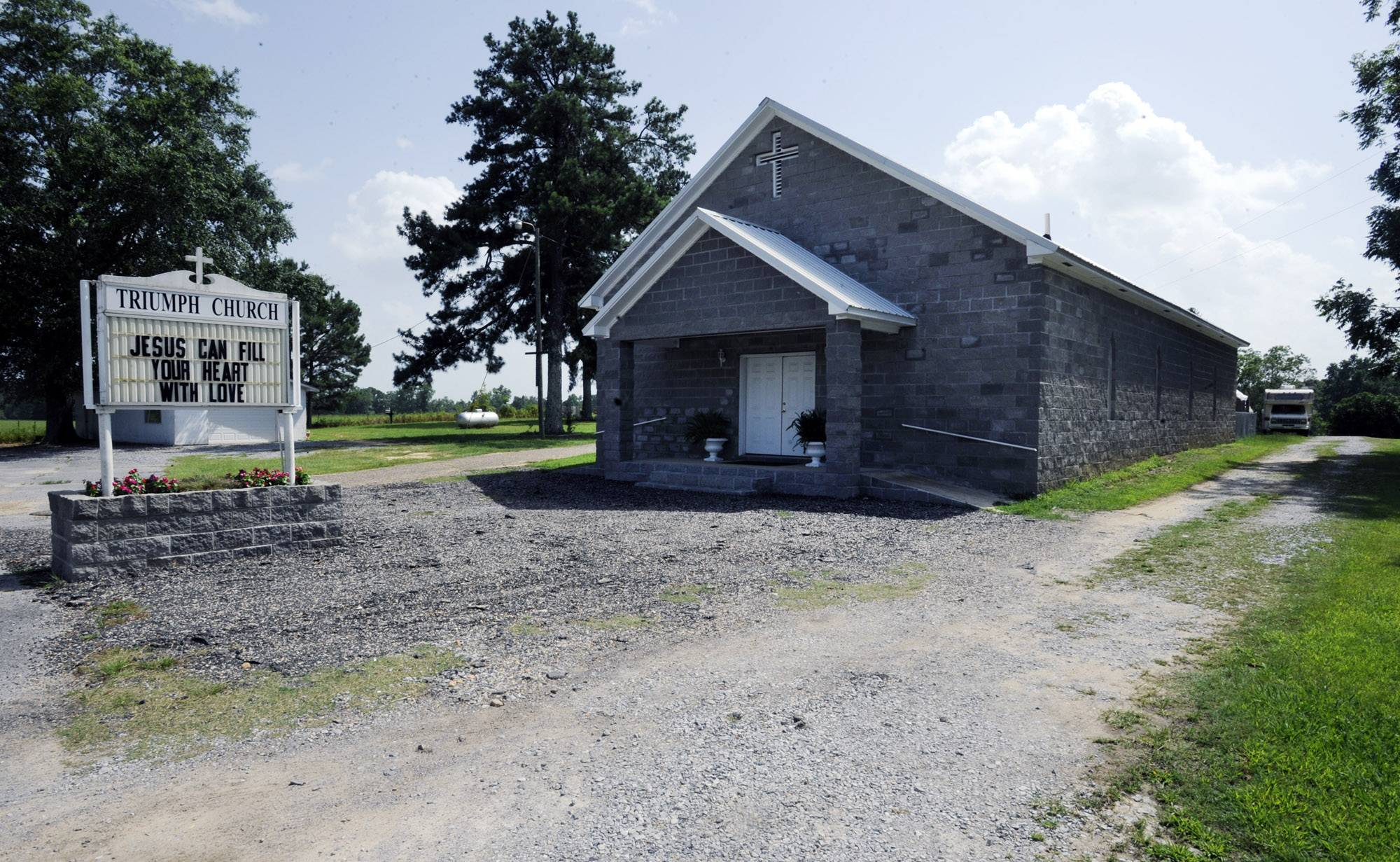 A gravel drive leads to a camp inhabited by convicted sex offenders behind Triumph Church near Clanton, Ala., on Monday. A law that took effect the next day shut down the refuge.