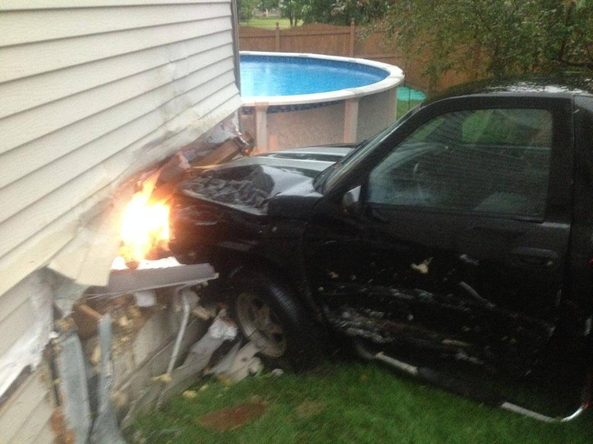 Adam K. Domini, the 23-year-old driver of this 1997 Dodge Ram, faces multiple charges after police said he drove into this house in the 10100 block of Bennington Drive Monday after ignoring a stop sign and striking a car, police said.