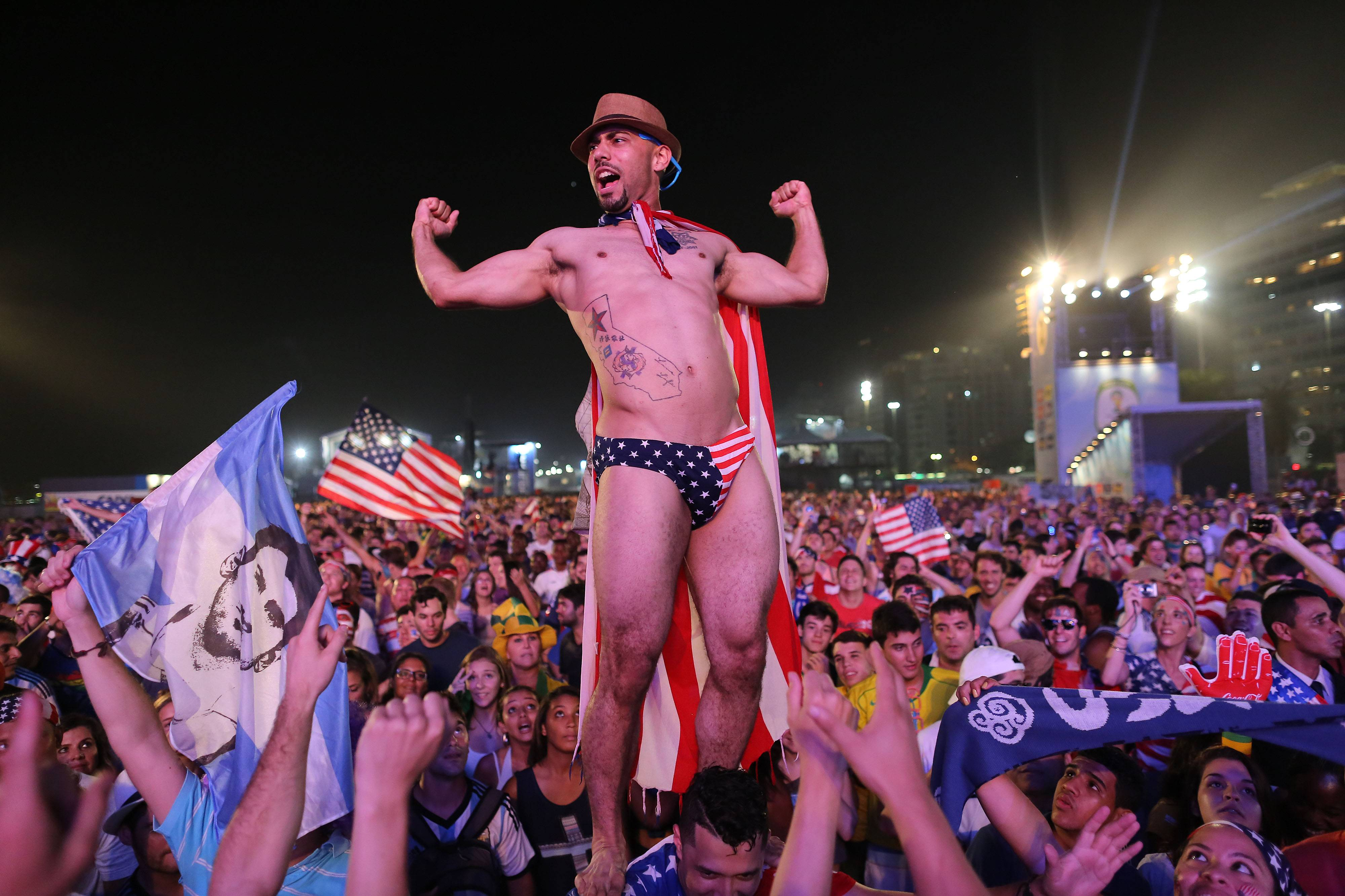 "Associated Press U.S. soccer fans cheer minutes before a live broadcast of the soccer World Cup match between USA and Ghana, during a music concert inside the FIFA Fan Fest area on Copacabana beach, Rio de Janeiro, Brazil. With ""I believe that we will win!"" American soccer fans finally have a World Cup chant that doesn't just involve shouting their country's name."