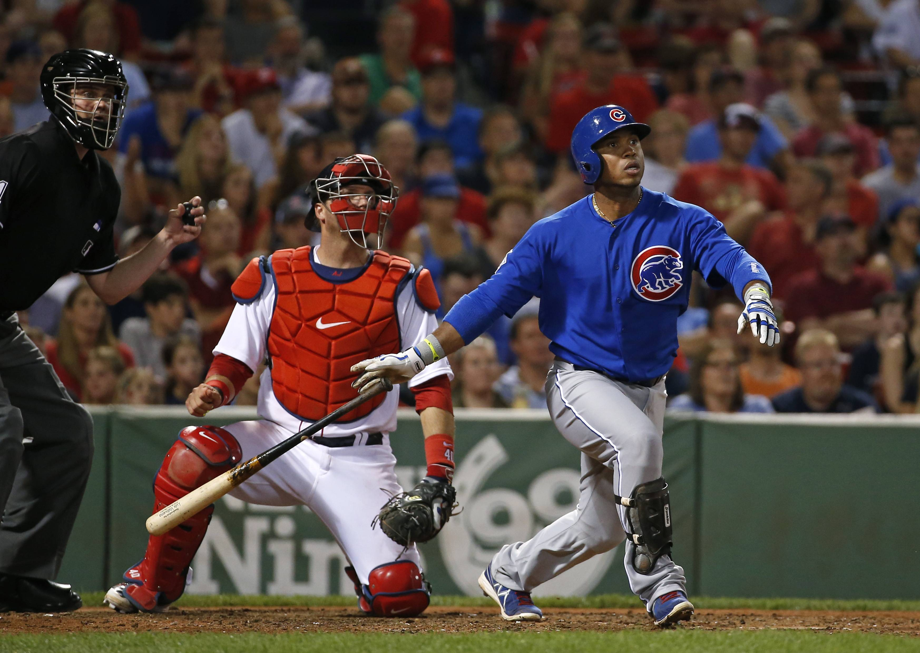 The Cubs' Luis Valbuena watches his RBI sacrifice fly in the ninth inning of Tuesday night's game at Fenway Park in Boston. The Cubs beat the Red Sox 2-1.