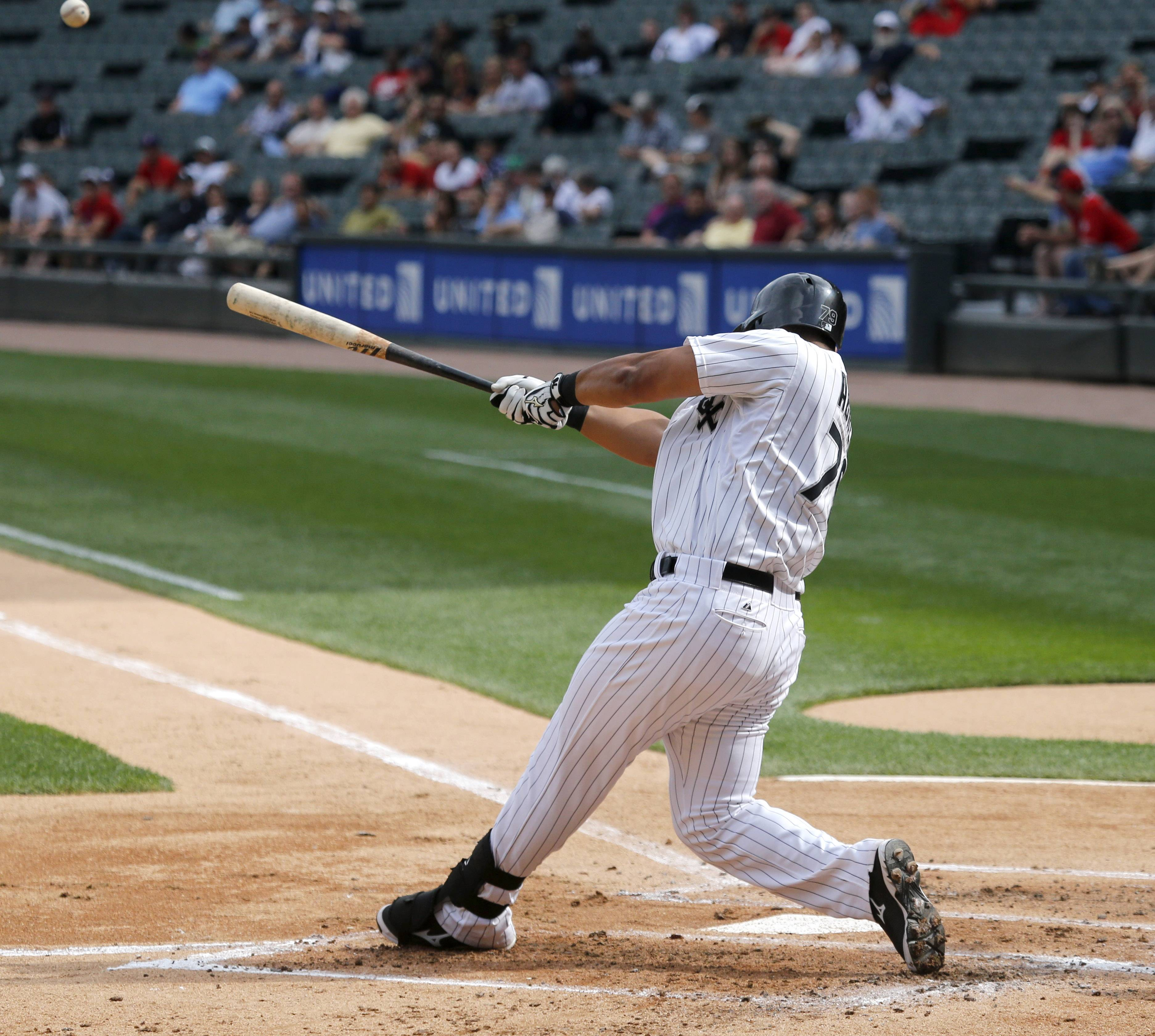 The White Sox's Jose Abreu hits a three-run home run off Los Angeles Angels starting pitcher Garrett Richards, also scoring Gordon Beckham and Adam Eaton, during the first game of a doubleheader Tuesday at U.S. Cellular Field. The Sox lost the first game 8-4.
