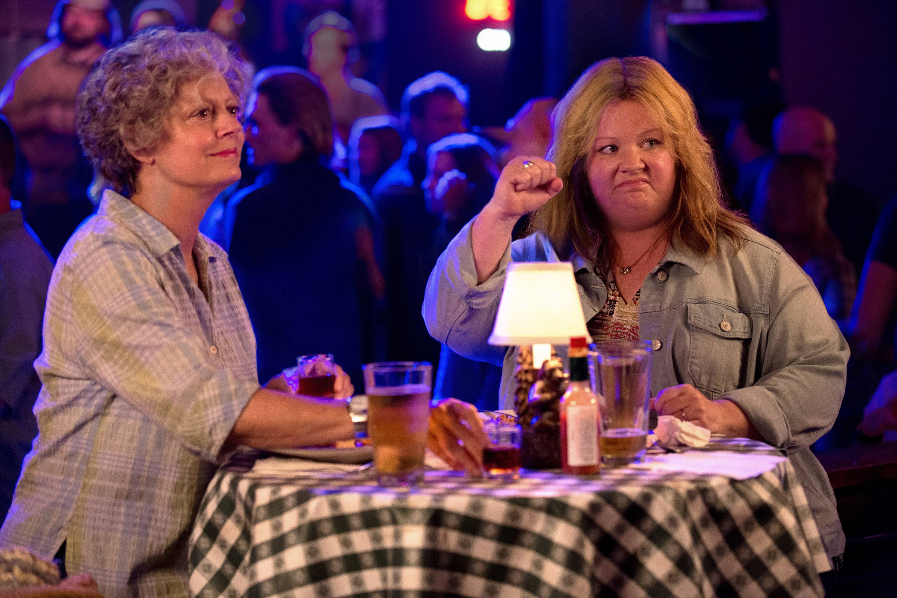 "Pearl (Susan Sarandon) and her granddaughter (Melissa McCarthy) share a rare peaceful moment in ""Tammy."""