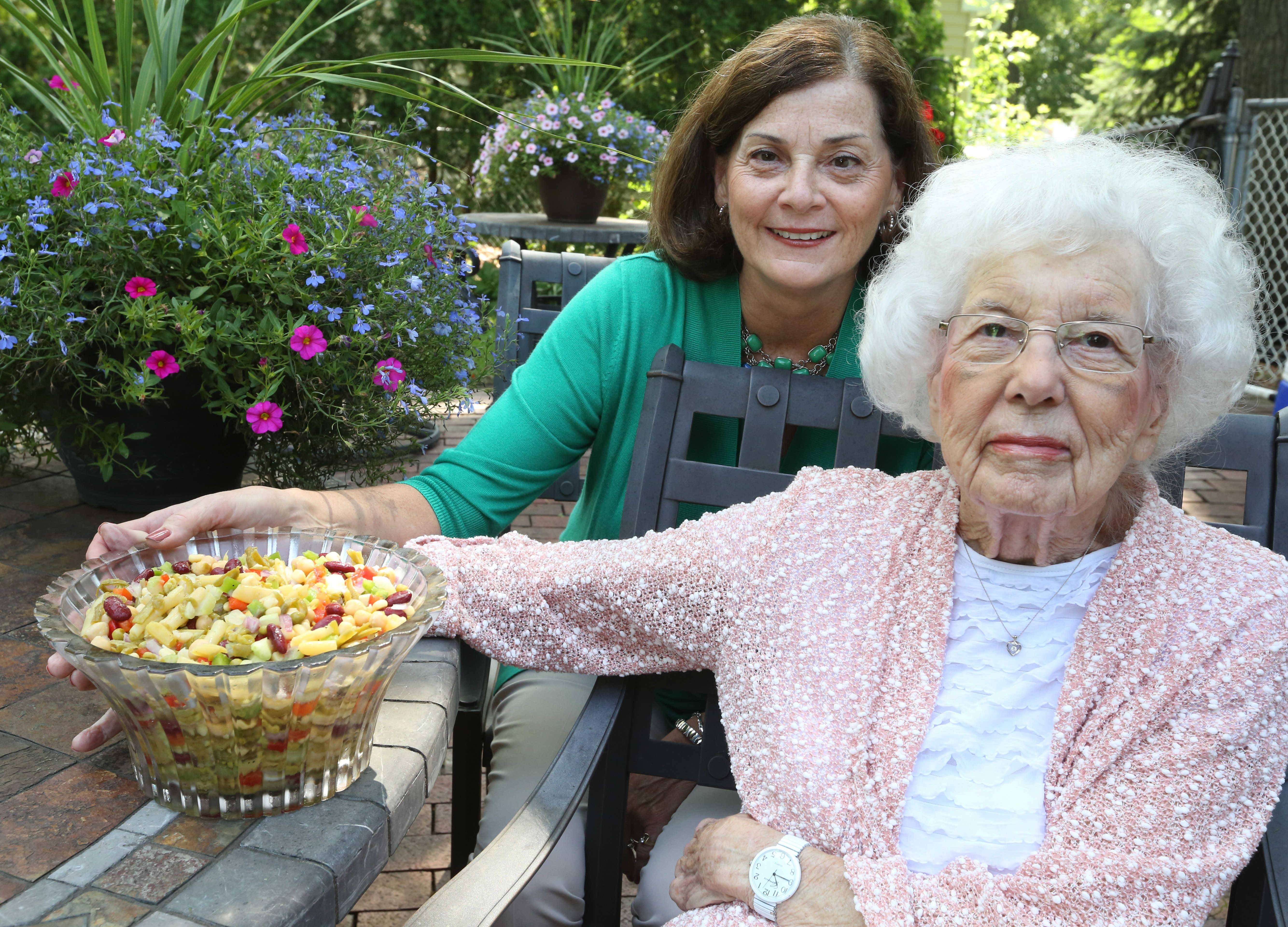 Jill Von Boeckman and her mother, Martha Grossweiler, of Arlington Heights, serve their bean-filled Mom's Vegetable Salad at summer cookouts and potlucks.