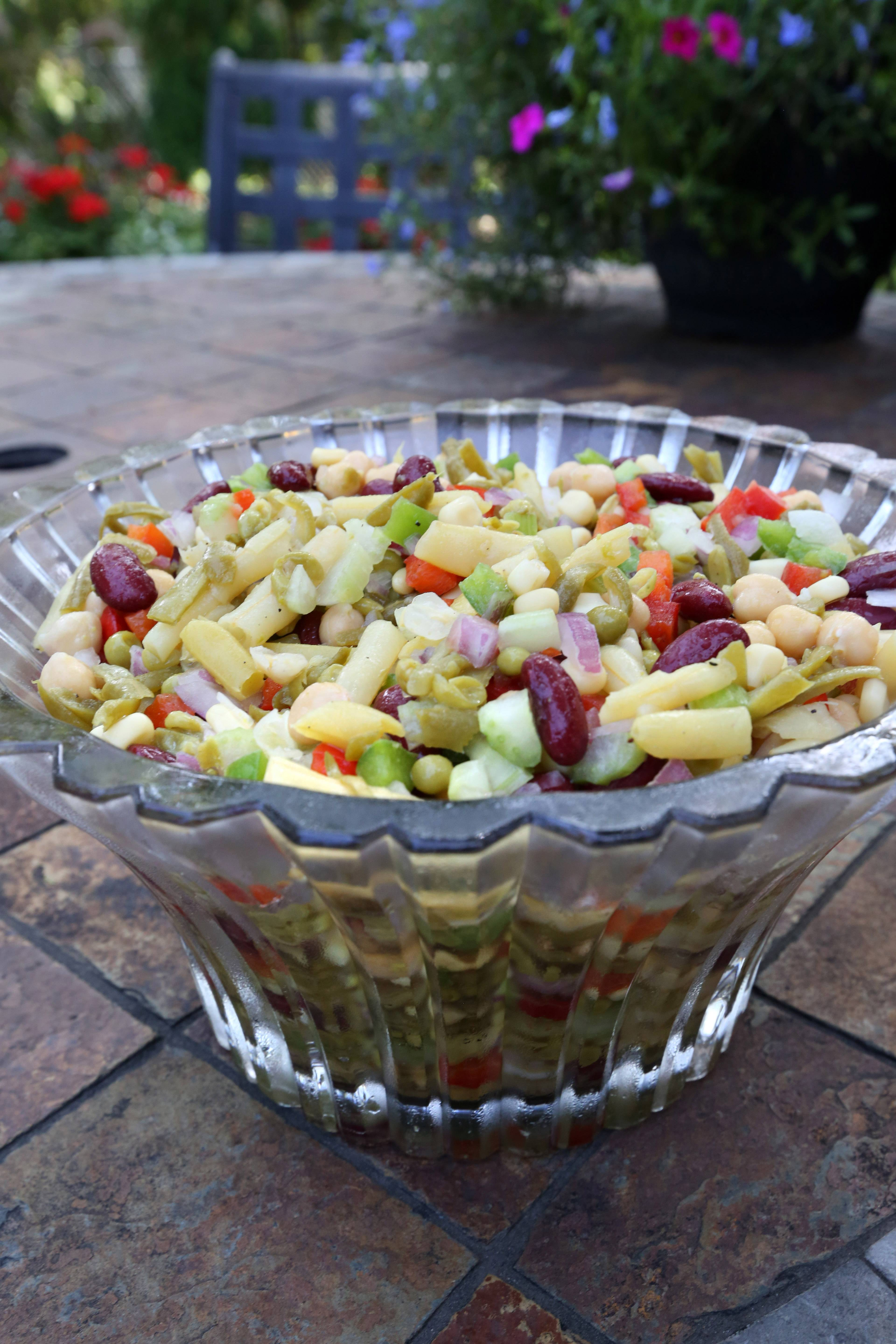 A variety of beans mingle with sweet peppers, onion and celery in a summery side dish that Jill Von Boeckman, of Arlington Heights, and her mother, Martha Grossweiler, have been sharing at family gatherings for years.