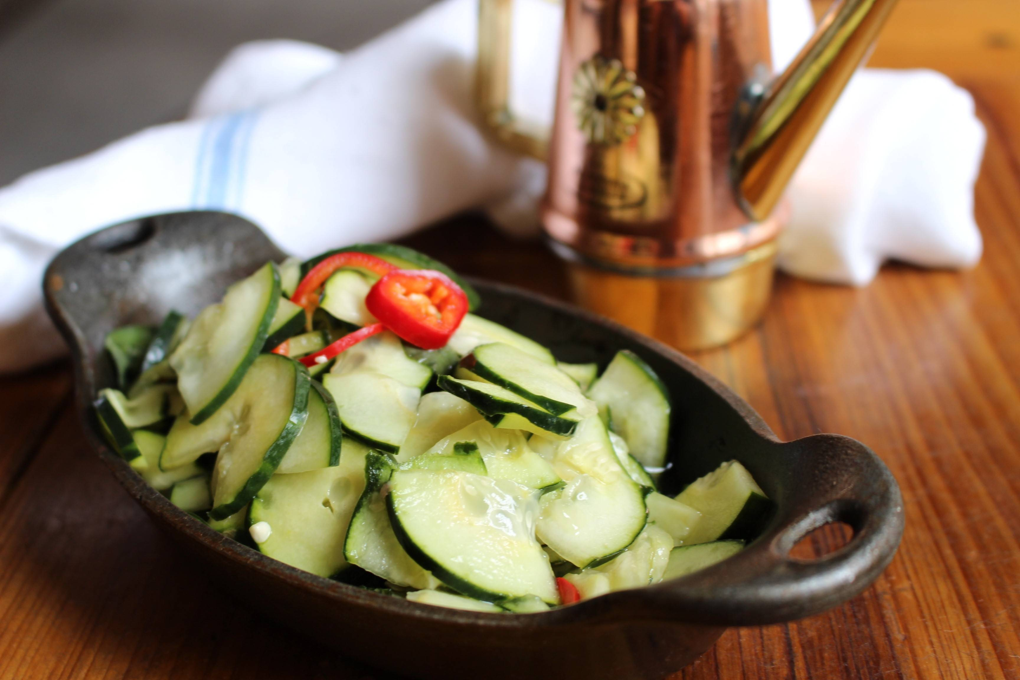 Basil and white wine transform cucumbers into a deliciously refreshing accompaniment to sausages and antipasto.