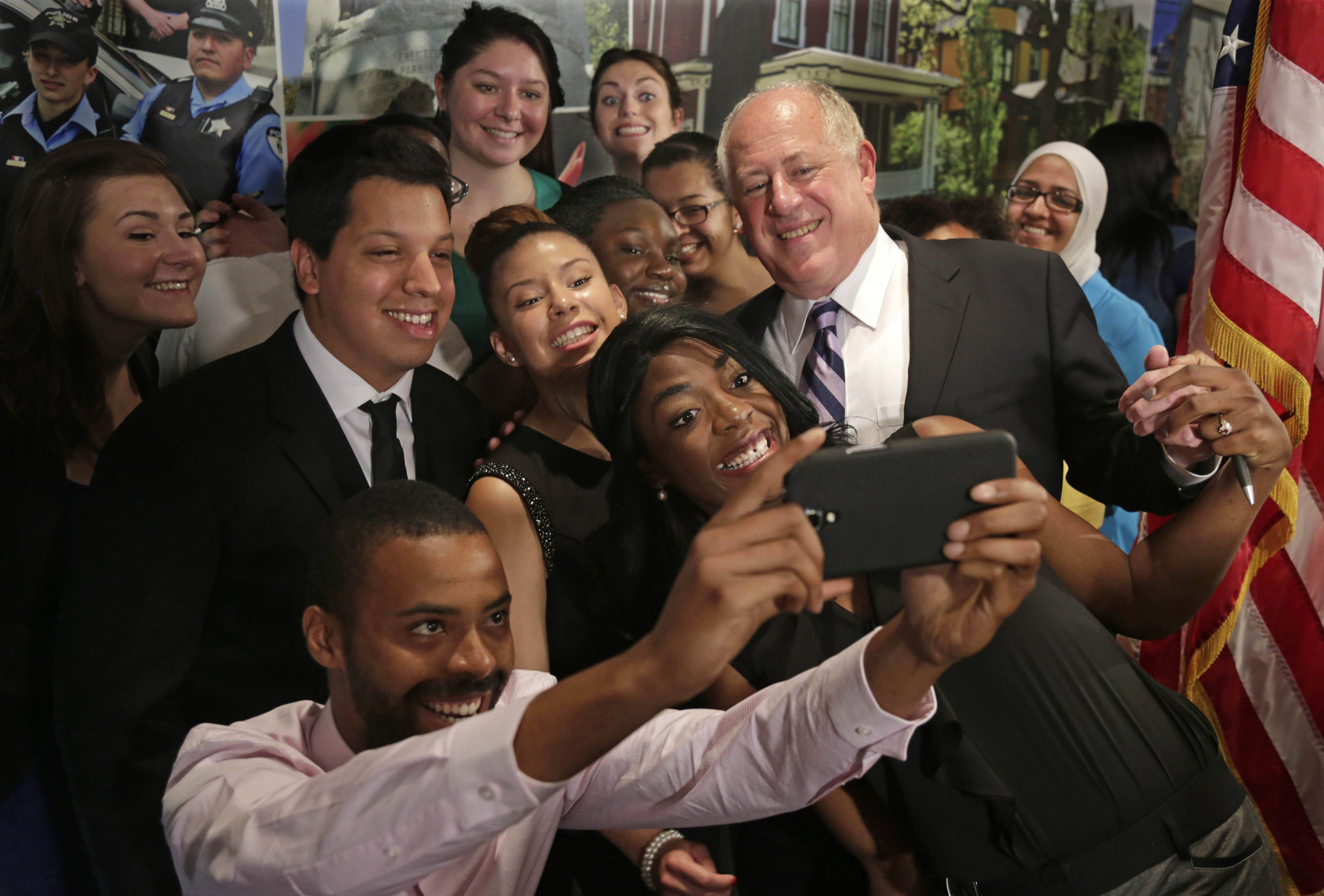 Gov. Pat Quinn poses for photos after signing a bill that will allow Illinois voters to register on Election Day, have more time to vote early, and not be required to bring photo identification to vote early Tuesday in Oak Park. The new law only applies to the November election.