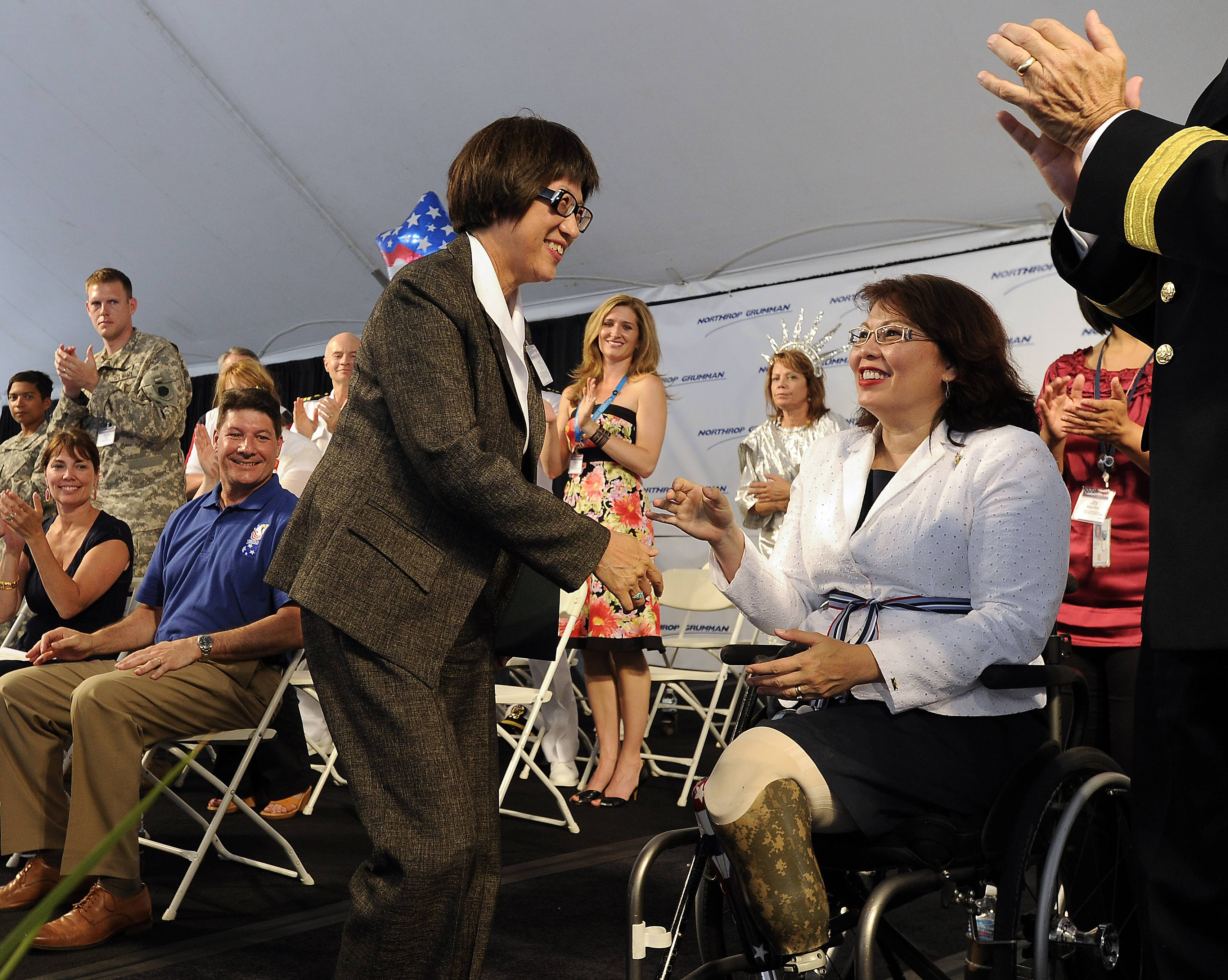 Congresswoman Tammy Duckworth, of Illinois' 8th District, is greeted by keynote speaker the Honorable Heidi Shyu, assistant secretary of the Army for acquisitions, logistics and technology at Northrop Grumman's 2014 America's Day on Tuesday in Rolling Meadows.