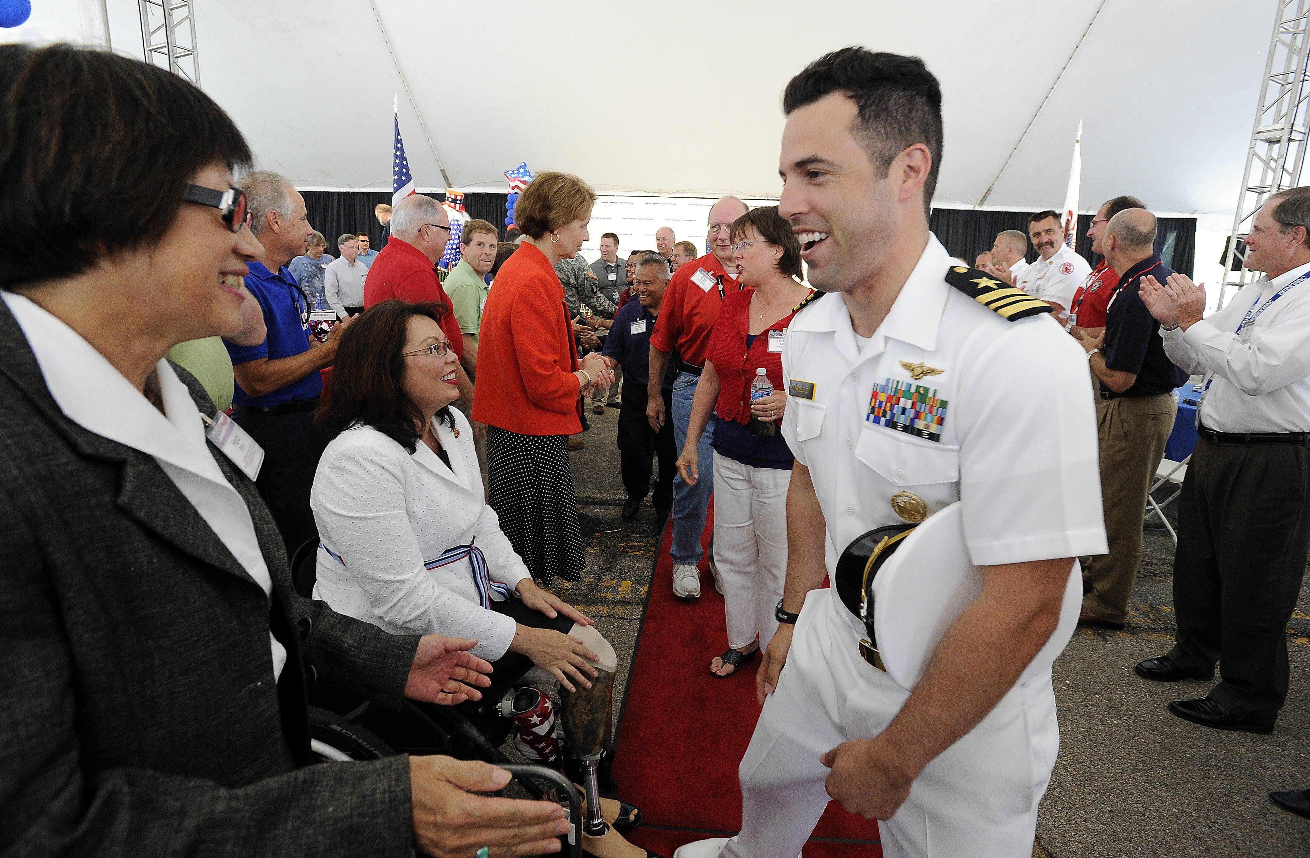 Lt. Cmdr. John Mikols of the Navy who lives in Rolling Meadows greet the Honorable Heidi Shyu, assistant secretary of the Army for acquisitions, logistics and technology and at Northrop Grumman's 2014 America Day on Tuesday in Rolling Meadows.