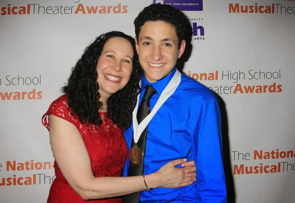 Jonah Rawitz of Buffalo Grove gets a hug from his mom Lauren after winning a Jimmy Award for best performance by an actor at the National High School Musical Theater Awards.