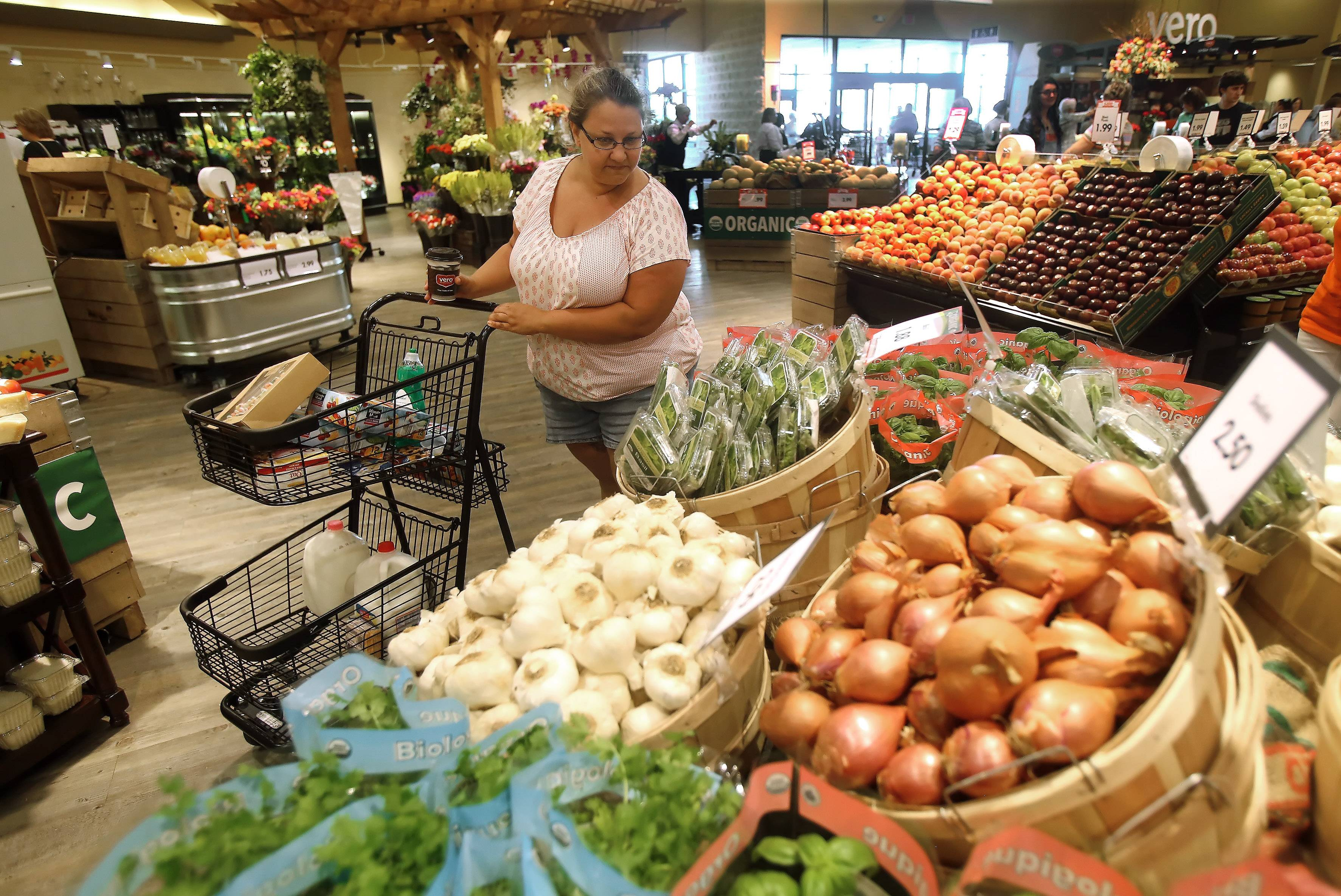 Former Dominick's cashier Kristen Niesen of Gurnee shops in the vegetable aisle during Tuesday's grand opening of Mariano's grocery store in Gurnee. Mariano's will add 470 new jobs to the area.