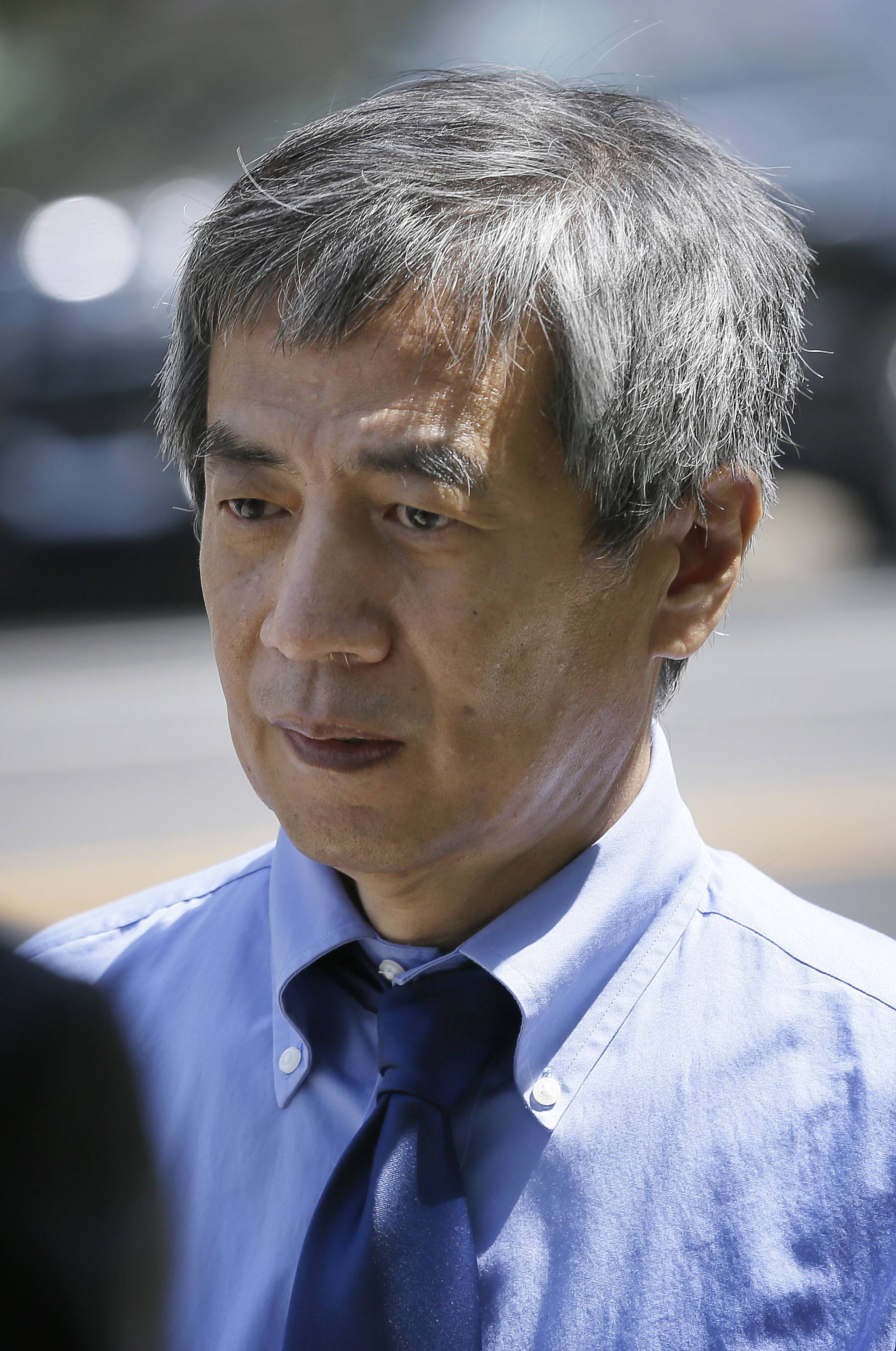 Former Iowa State University researcher Dong-Pyou Han leaves the federal courthouse Tuesday in Des Moines, Iowa.