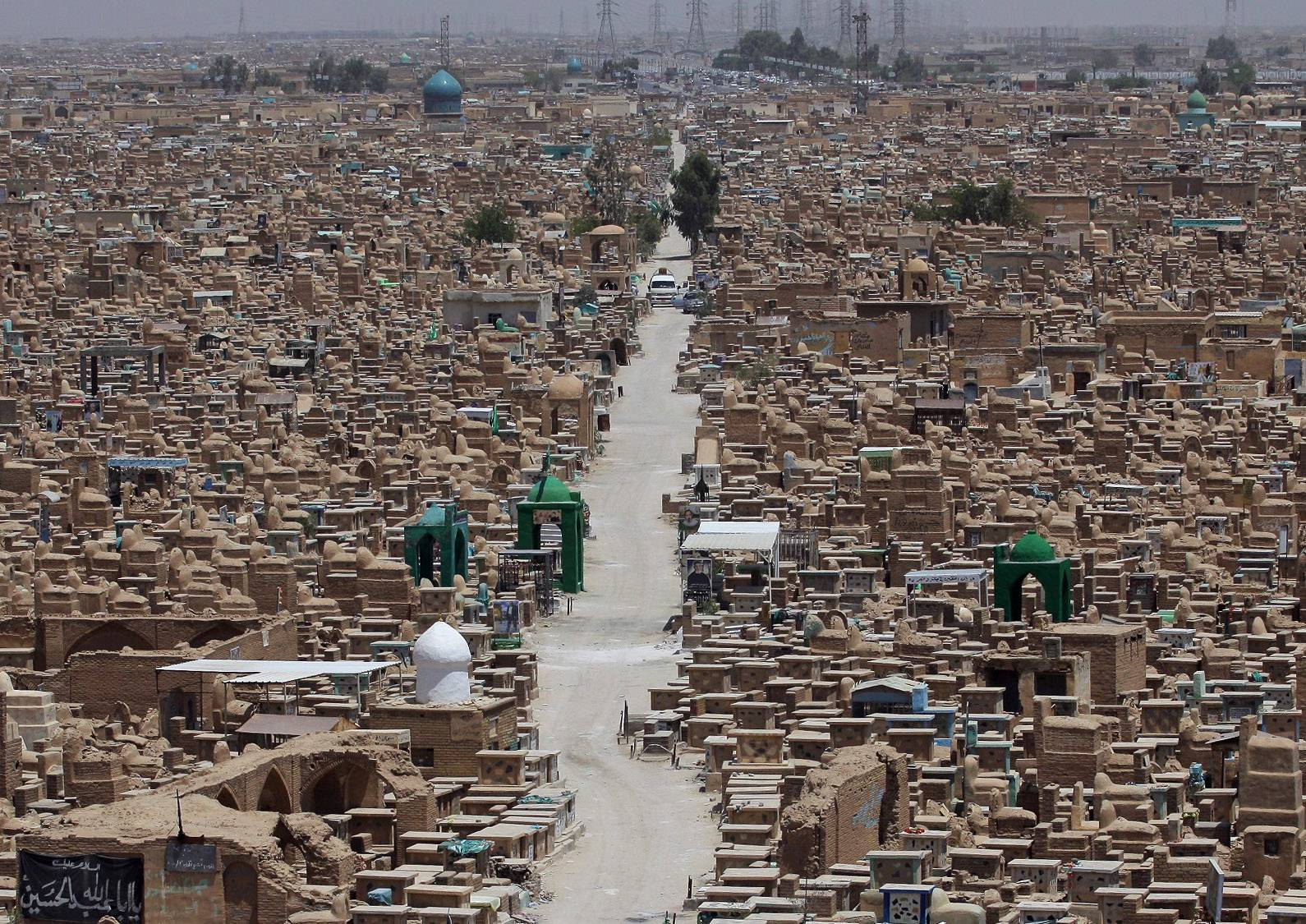 "This is a general view of the Wadi al-Salam, or ""Valley of Peace"" cemetery in the Shiite holy city of Najaf, 100 miles south of Baghdad. Violence has claimed the lives of 2,417 Iraqis in June, making it the deadliest month so far this year, the United Nations said on Tuesday, underlining the daunting challenge the government faces as it struggles to confront Islamic extremists who have seized large swaths of territory in the north and west."