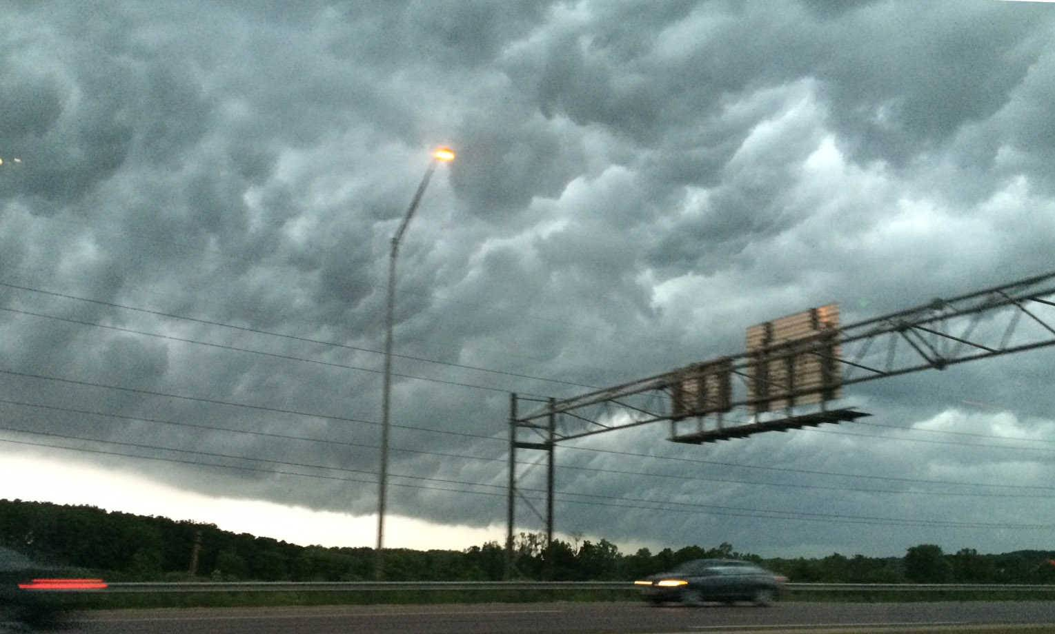 Storm clouds roll along the Jane Addams Memorial Tollway on Monday evening.