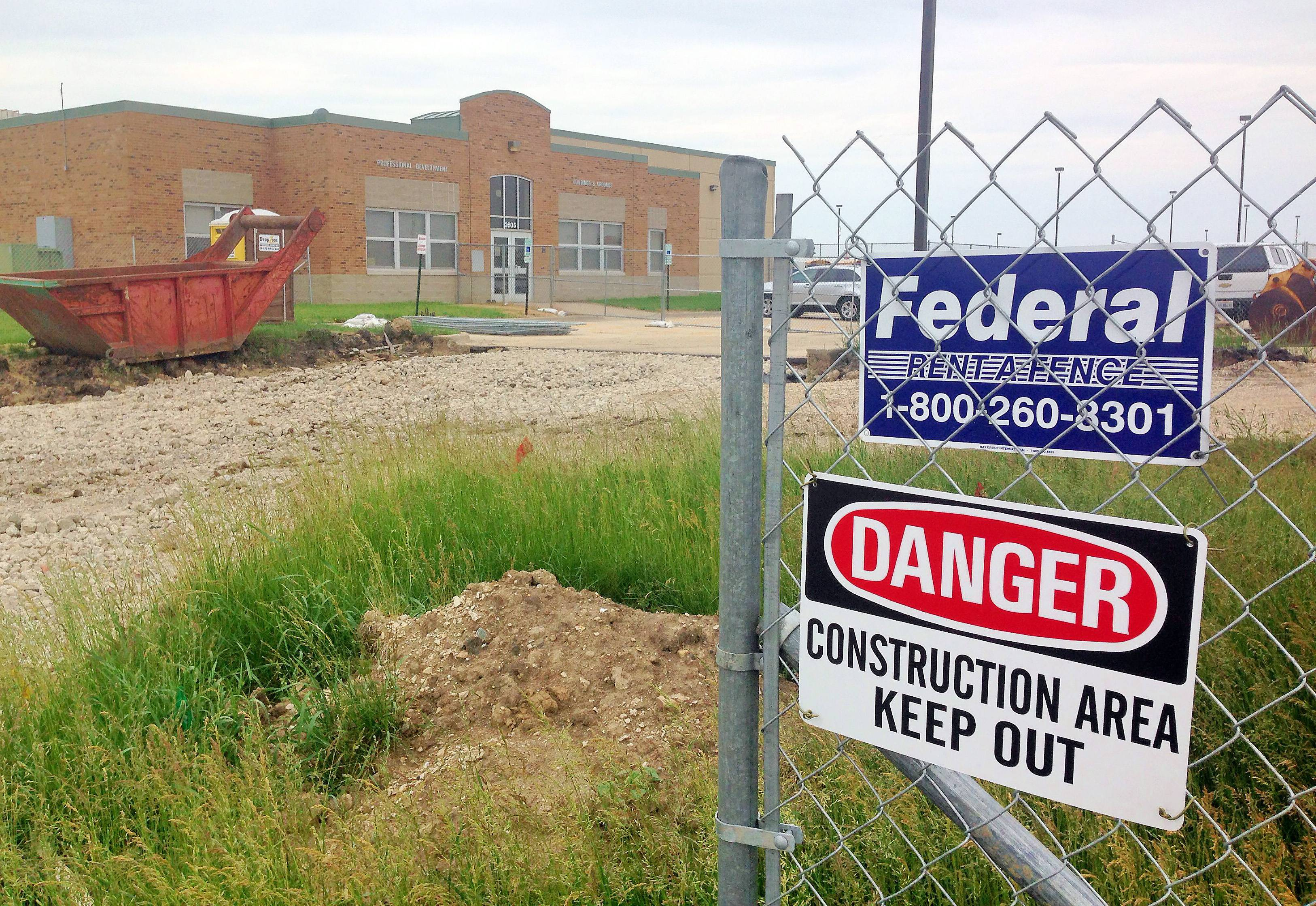 Construction is ongoing at the new Community Unit District 300 administration building in Algonquin. The district hasn't decided how to pay for the $3.9 million project, but a pair of officials say an anticipated $35 million to $60 million from the state won't come through in time to cover the costs.