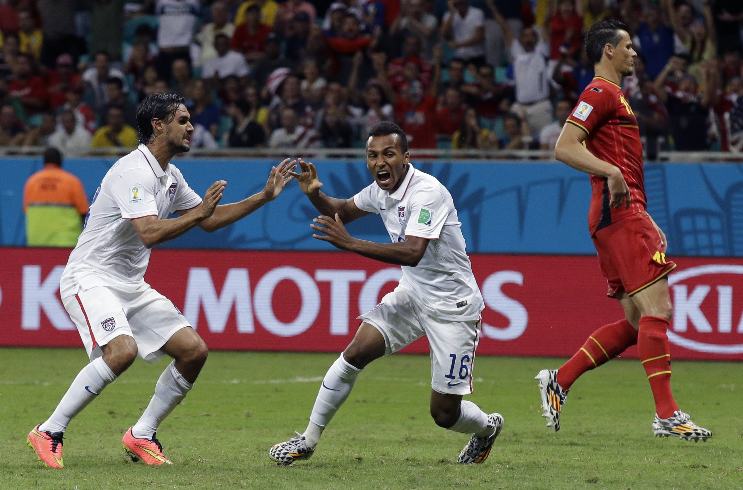Julian Green, middle, celebrates after scoring the United States' goal Tuesday during the World Cup Round of 16 match won by Belgium 2-1.