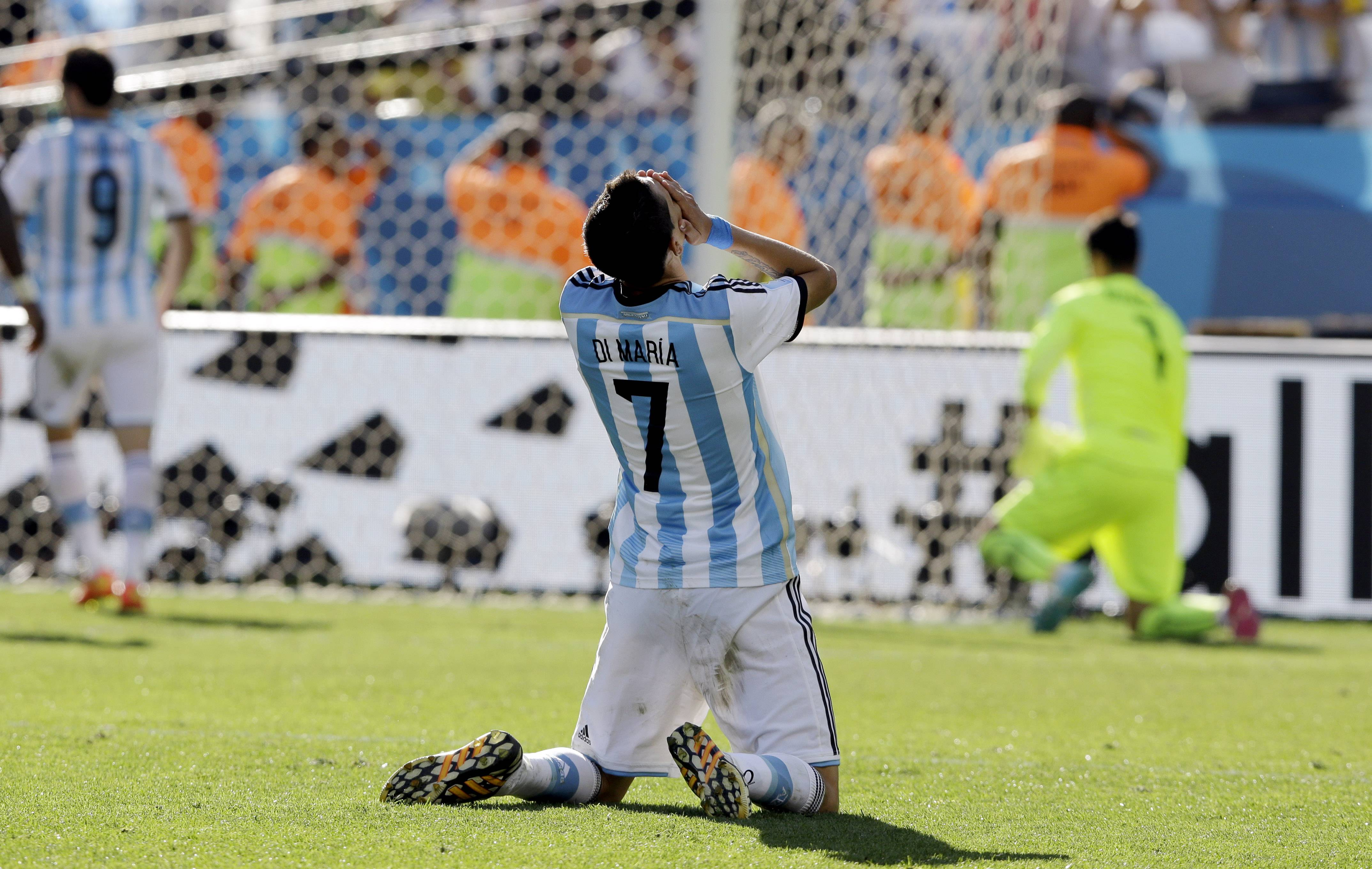 Argentina's Angel di Maria reacts after missing a chance to score Tuesday during the World Cup round of 16 soccer match against Switzerland at the Itaquerao Stadium in Sao Paulo, Brazil. Argentina beat Switzerland 1-0 after extra time.