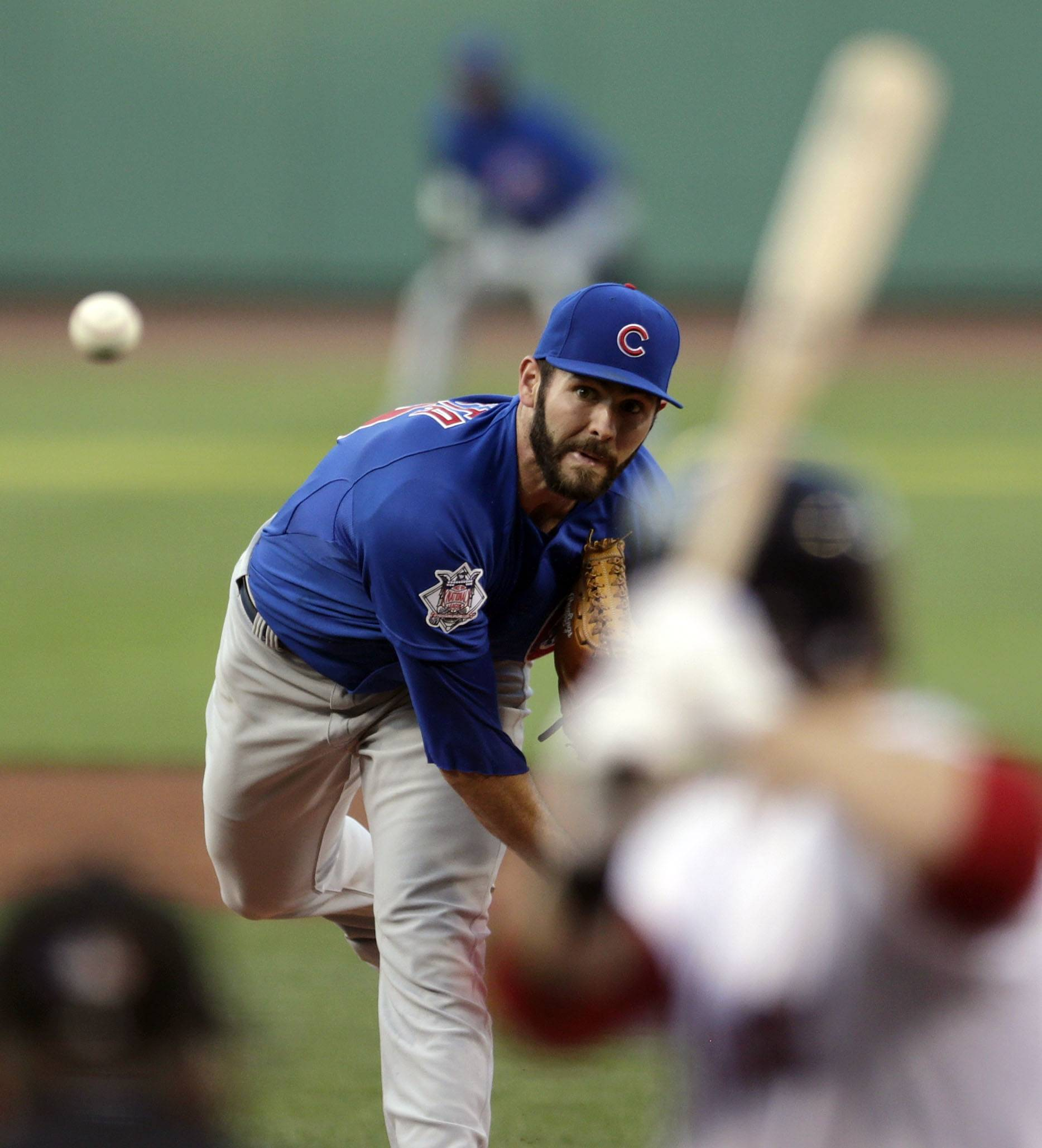 Cubs starter Jake Arrieta walked one and struck out 10 before giving up his first hit with two outs in the eighth inning Monday night. He left to a standing ovation from Red Sox fans.
