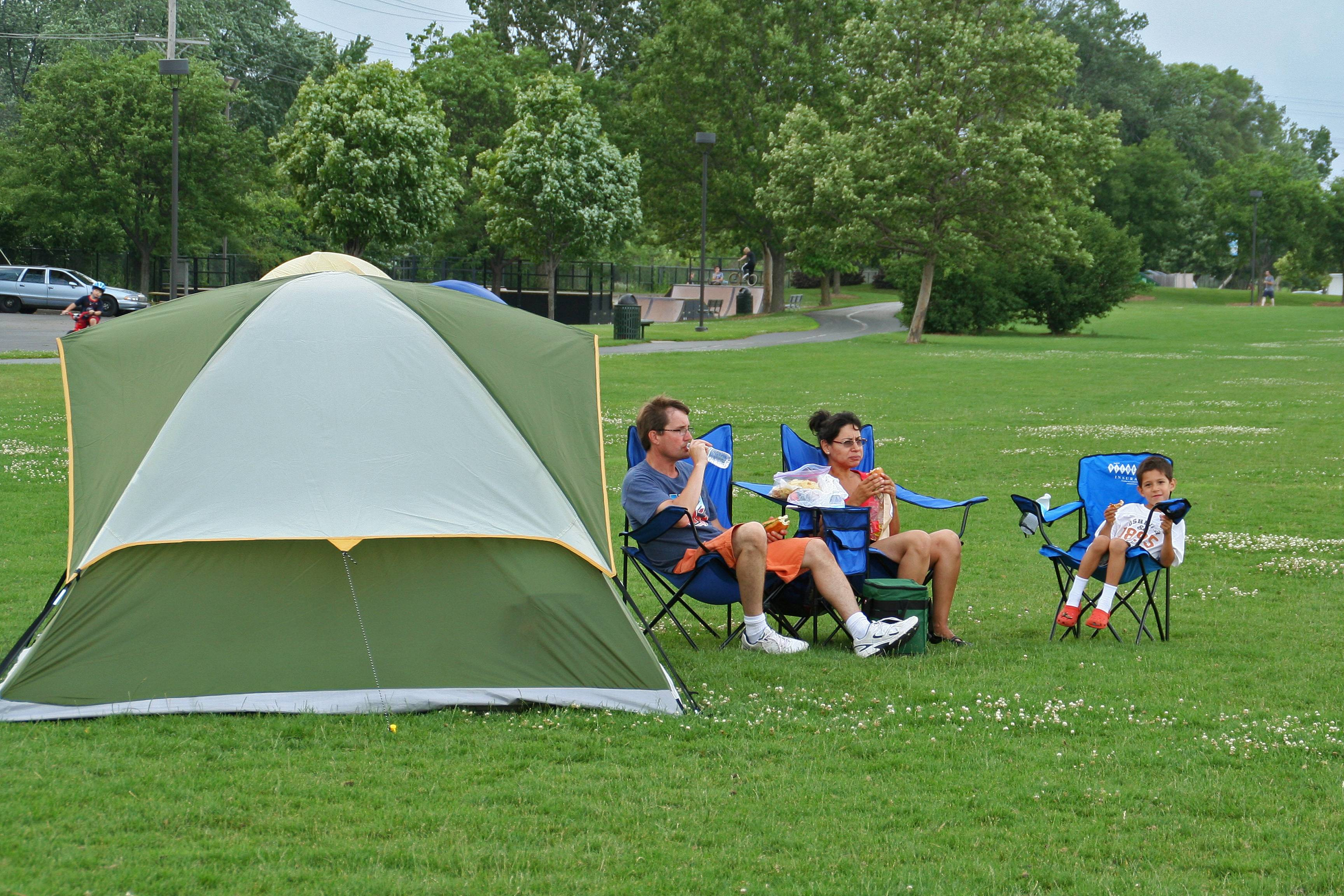 The Meyer family enjoys a leisurely dinner in Prairie Lakes Park at the third annual Family Campout on June 28.Lisa Haring