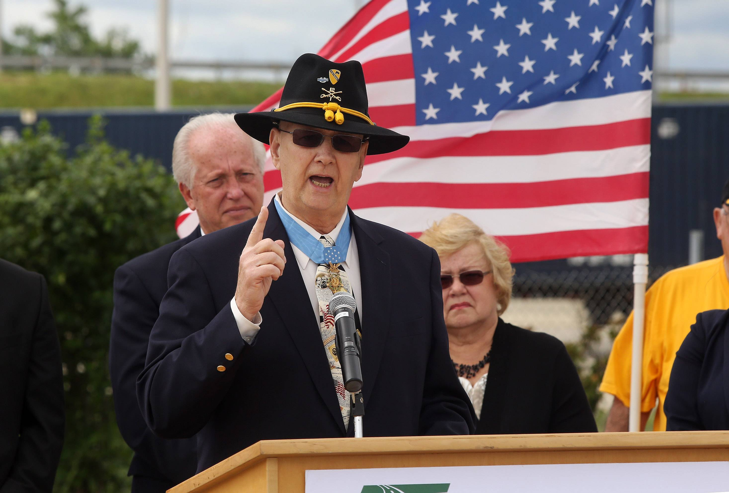 Medal of Honor recipient Allen J. Lynch of Gurnee speaks Wednesday at the dedication of the Allen J. Lynch Medal of Honor Overpass at Grand Avenue and the Tri-State Tollway in Gurnee.