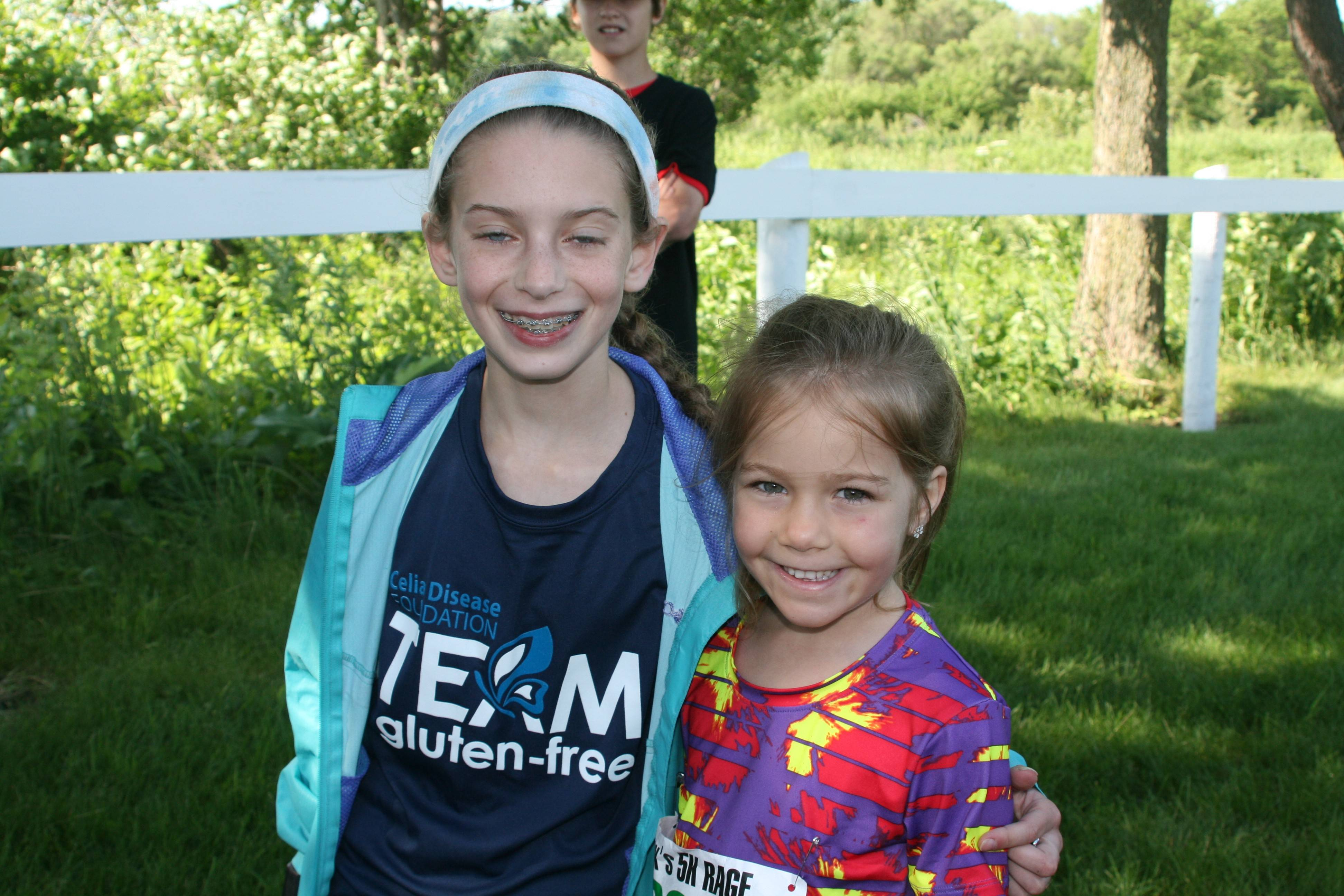 Alex Morris, left, congratulates Grace Lube, who won the girls 10 and younger age division in Alex's 5K RAGE, a race that raised nearly $9,000 for the Celiac Foundation. Alex, who planned the race, and Grace both have Celiac disease and must eat a gluten-free diet.
