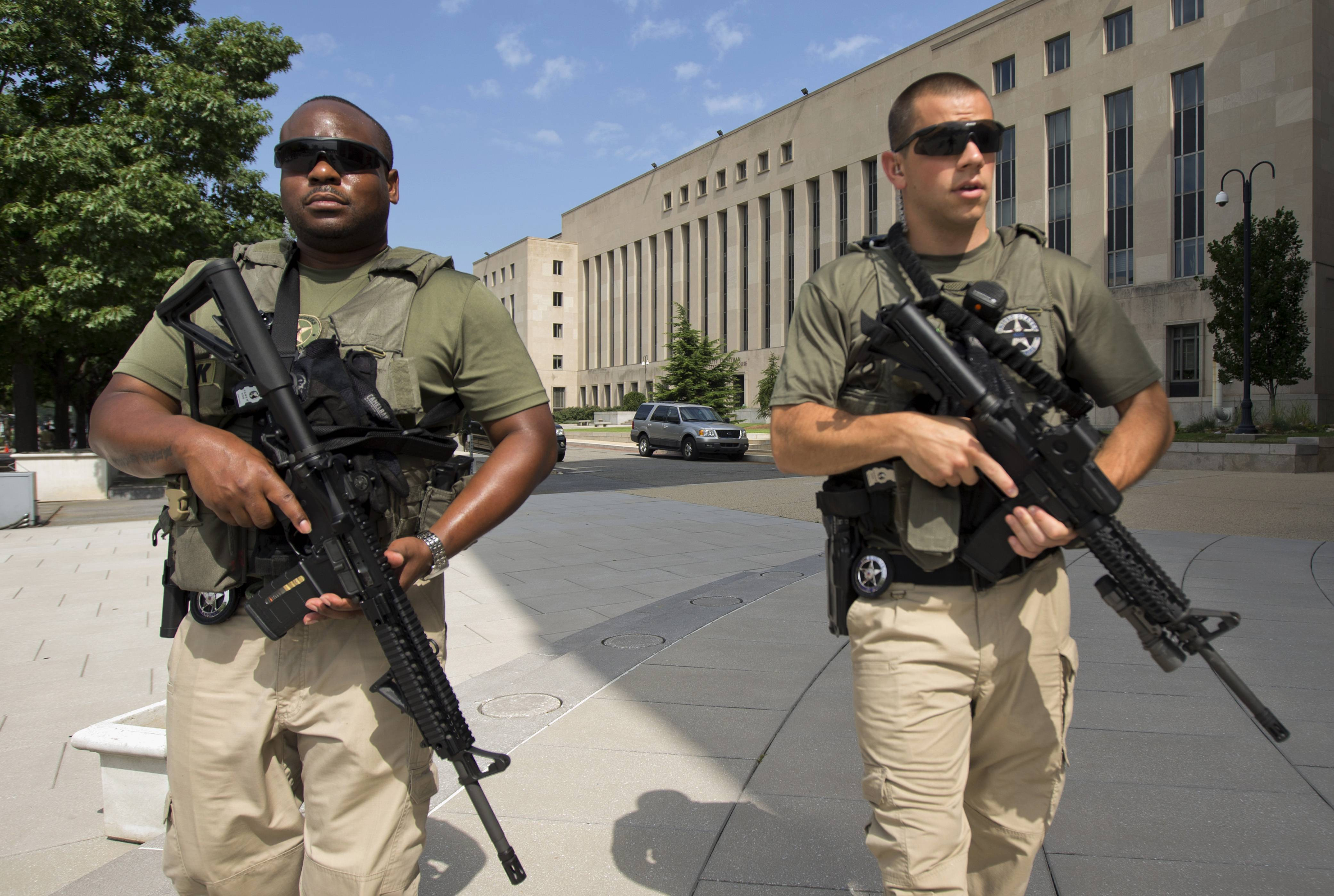 U.S. Marshals patrol the area outside federal court Wednesday in Washington, where Libyan militant Ahmed Abu Khattala, charged in the deadly attack at the U.S. diplomatic outpost in Benghazi, was being held for a detention hearing.