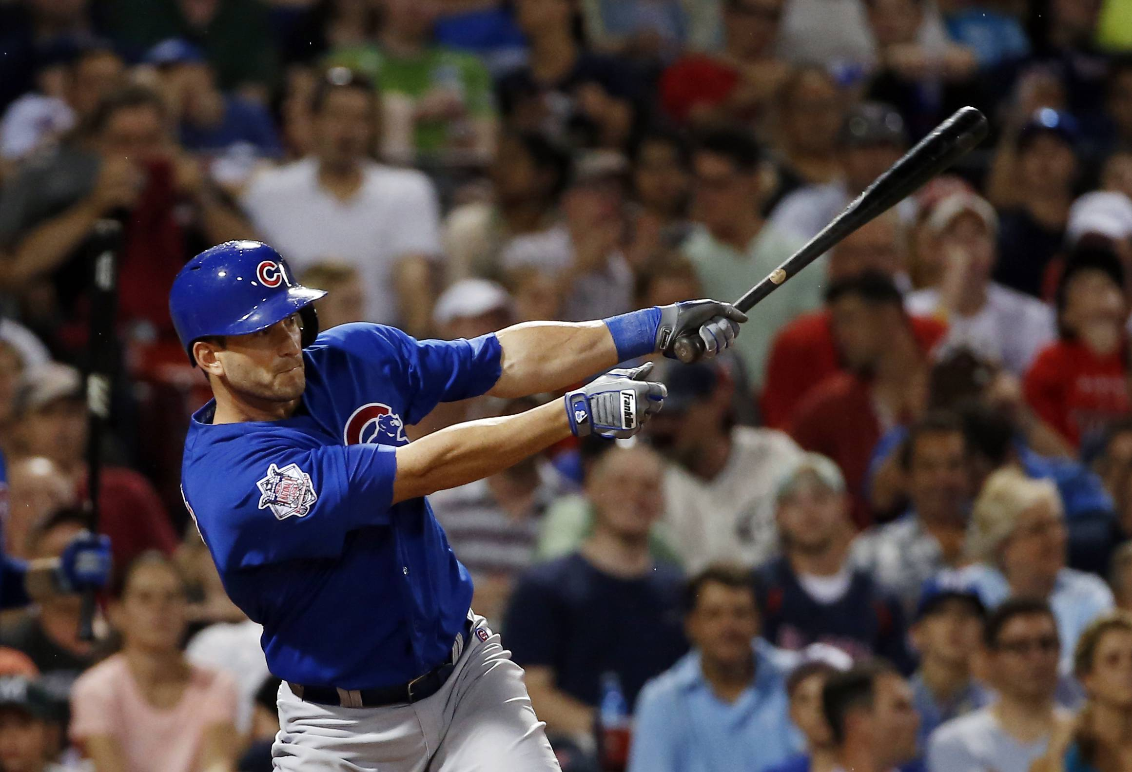 The Cubs' Justin Ruggiano delivers an RBI-single in the sixth inning Wednesday against the Red Sox. Ruggiano had homered earlier in the game.