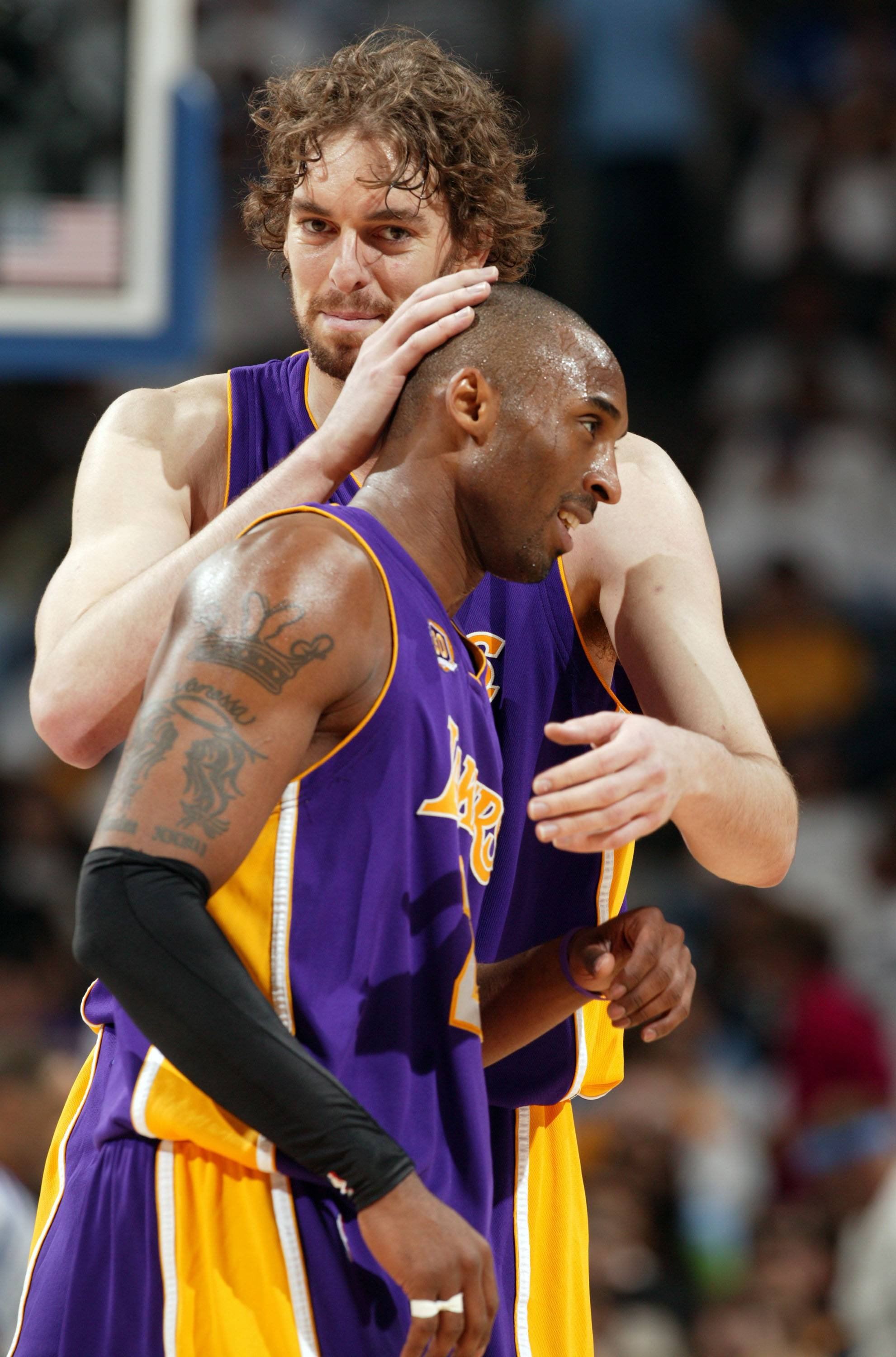 The Lakers' Pau Gasol, back, shares a momemt with teammate Kobe Bryant.