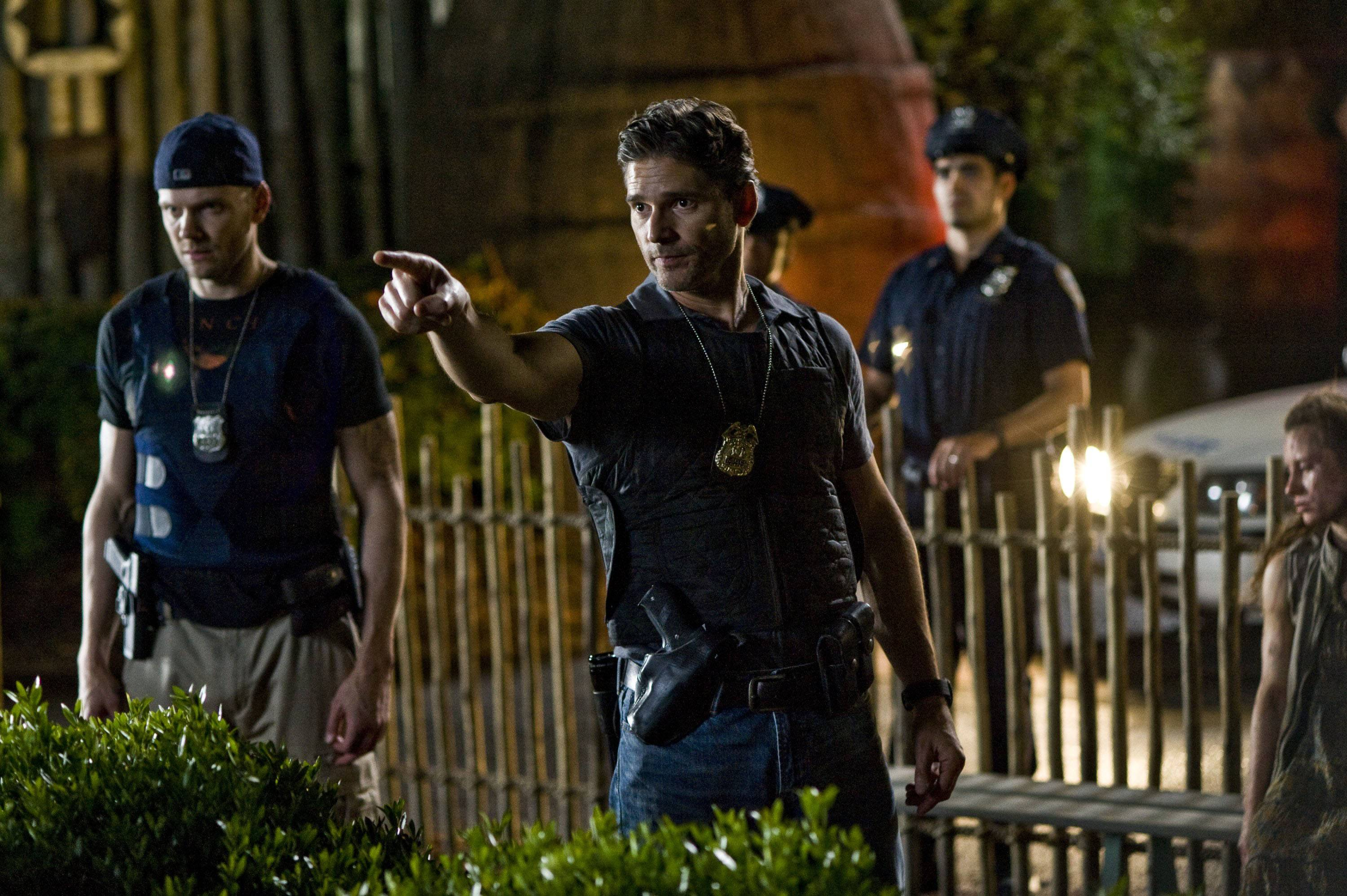 Butler (Joel McHale), left, and Sarchie (Eric Bana) confront something strange at the zoo.