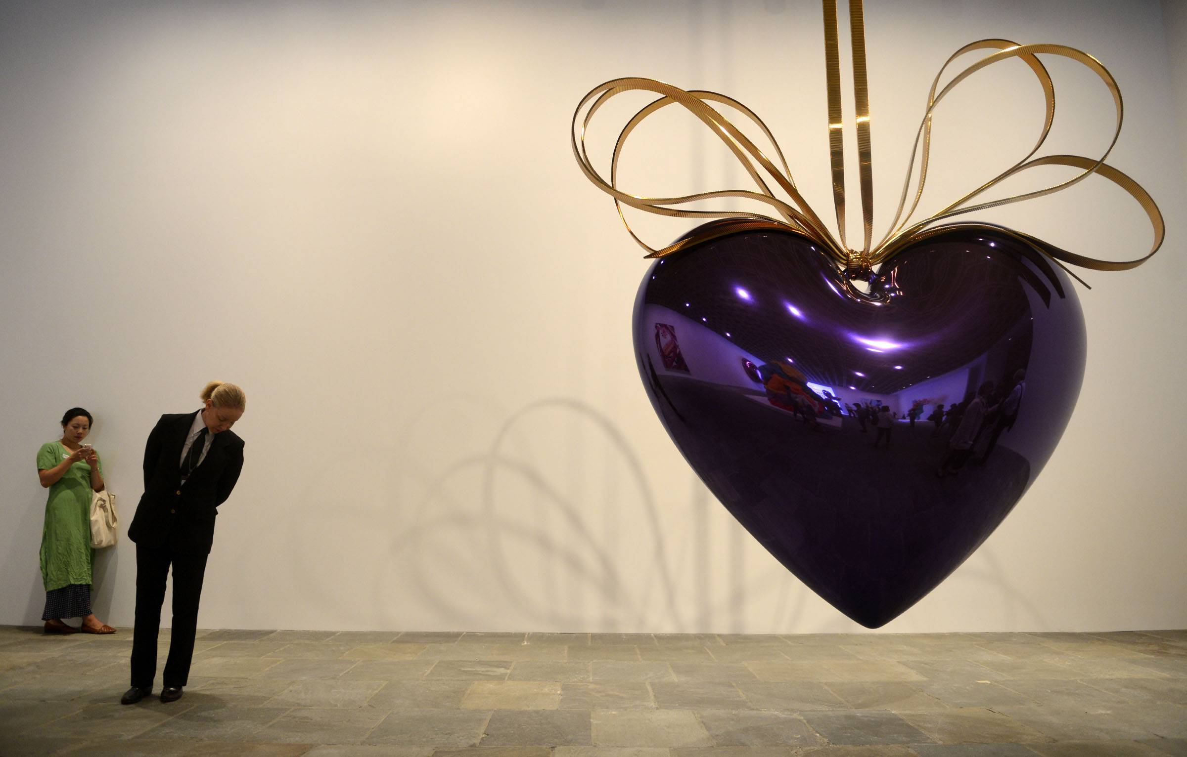 """Hanging Heart"" is displayed during the media preview of ""Jeff Koons: A Retrospective"" at the Whitney Museum of American Art in New York."
