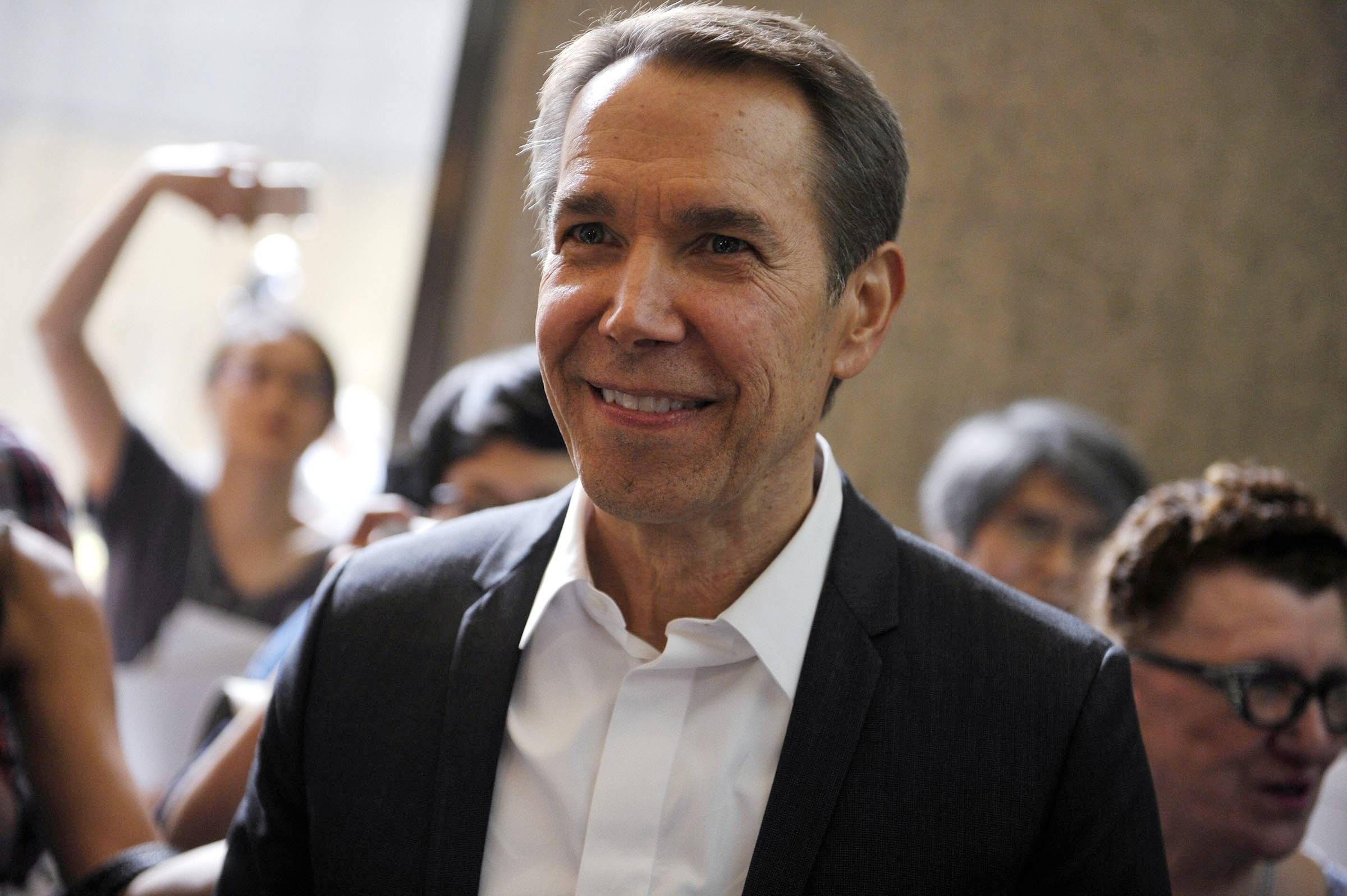 "Jeff Koons attends the media preview of ""Jeff Koons: A Retrospective"" at the Whitney Museum of American Art in New York. The exhibit runs through Oct. 19."