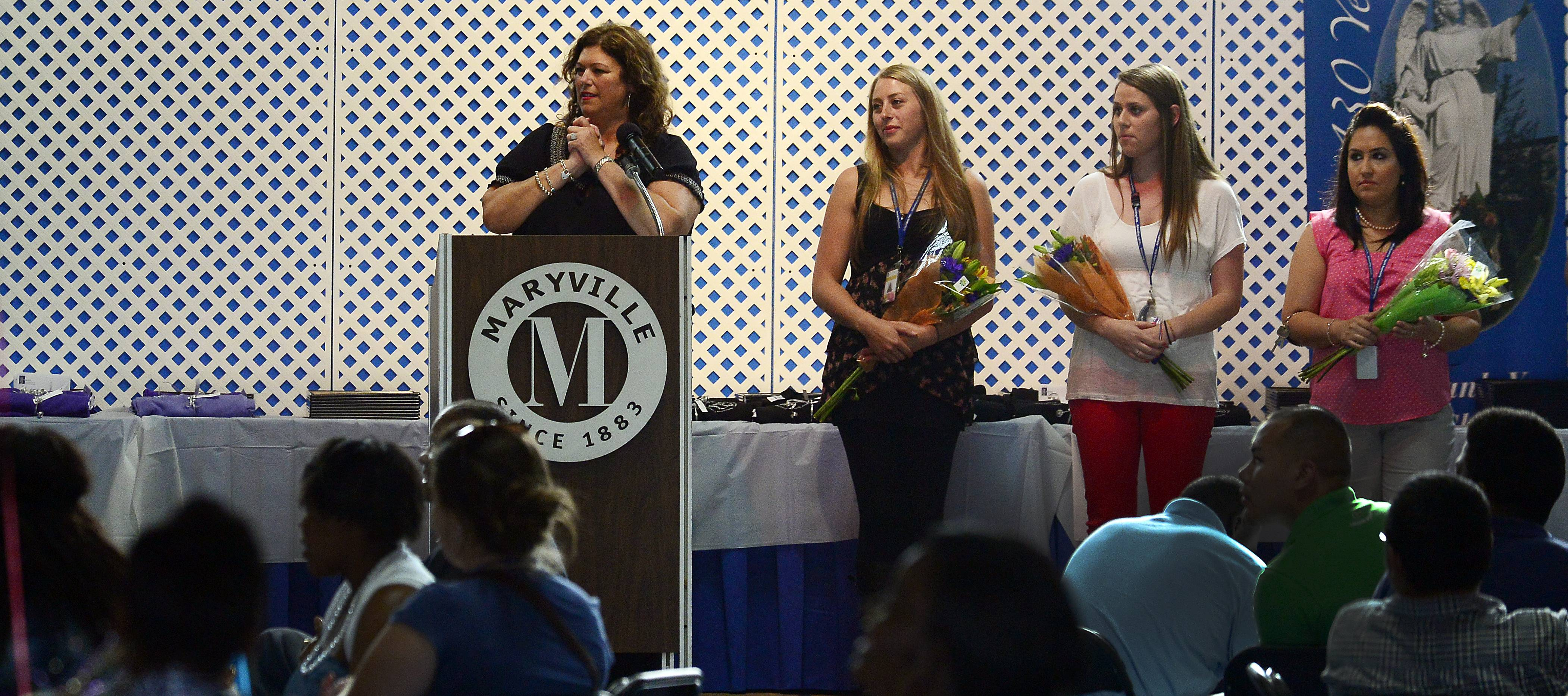 Awards and flowers were presented to Maryville employees for working toward their master's degree at awards night at Maryville's Des Plaines campus.