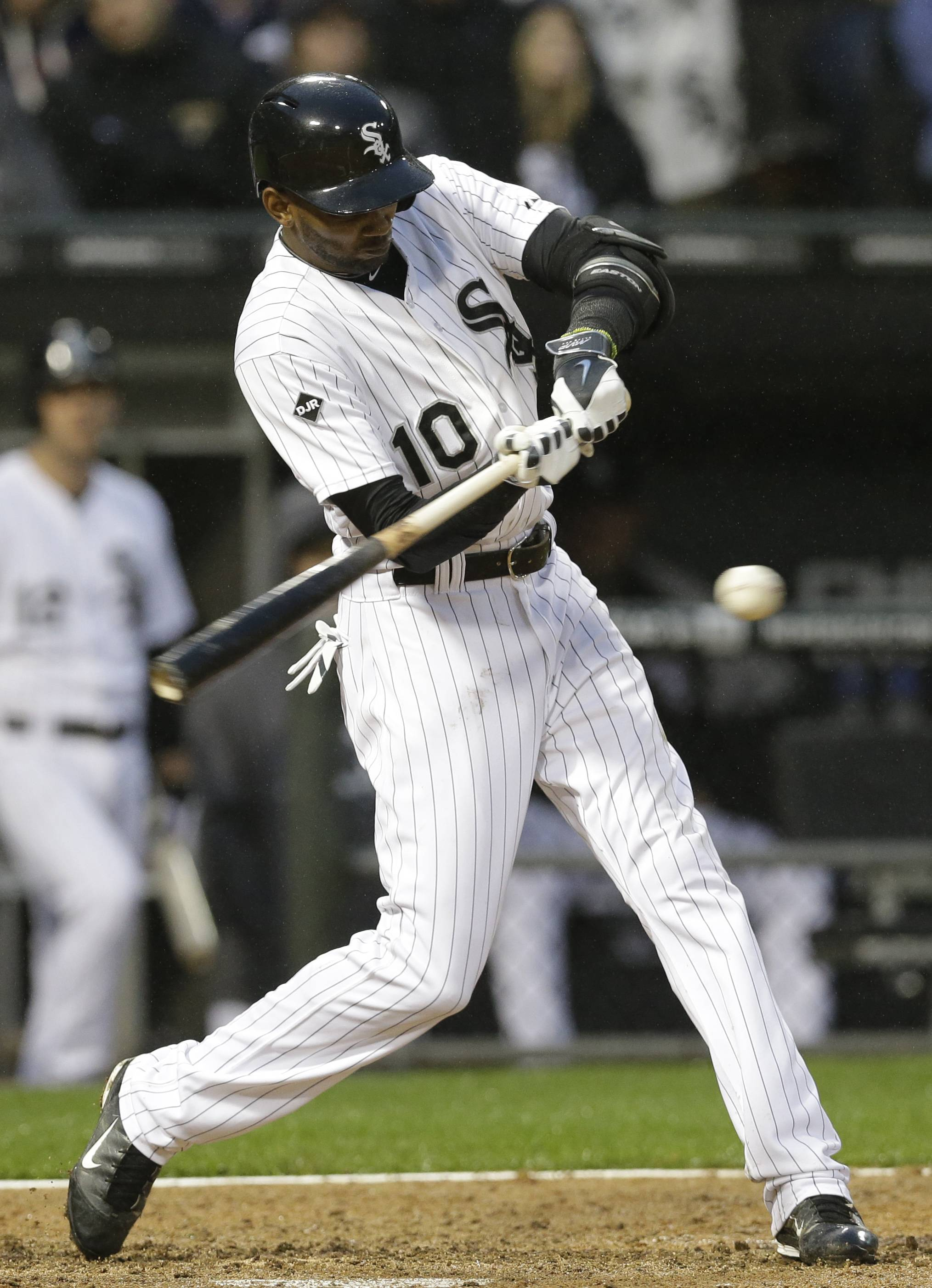 Alexei Ramirez hits a two-run single against the Los Angeles Angels during the fourth inning of a baseball game in Chicago on Wednesday, July 2, 2014.