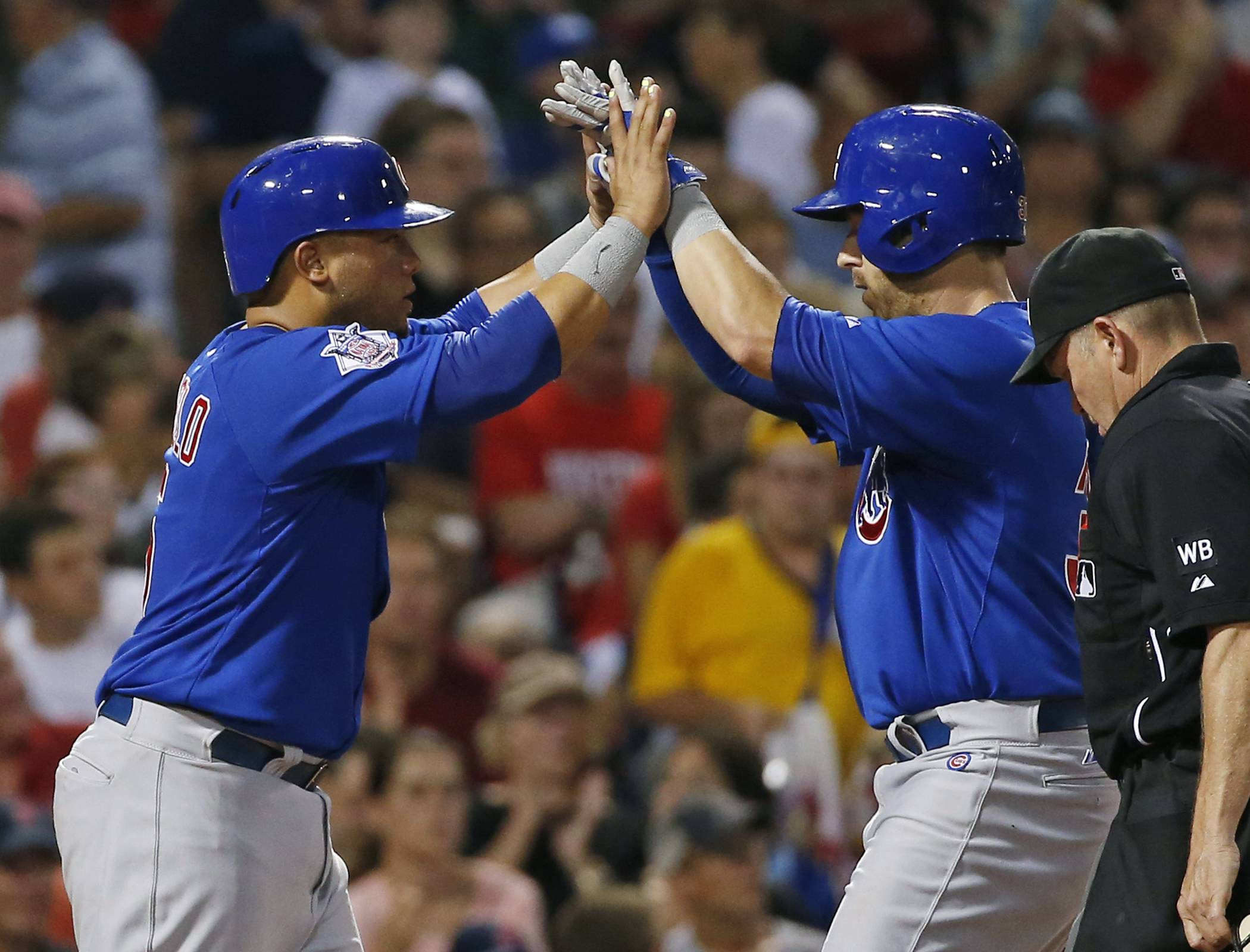 The Cubs' Mike Olt, right, celebrates his 2-run homer with Welington Castillo on Wednesday at Fenway Park in Boston. Castillo, Justin Ruggiano and Nate Schierholtz also homered as the Cubs outhit the Red Sox 19-16.