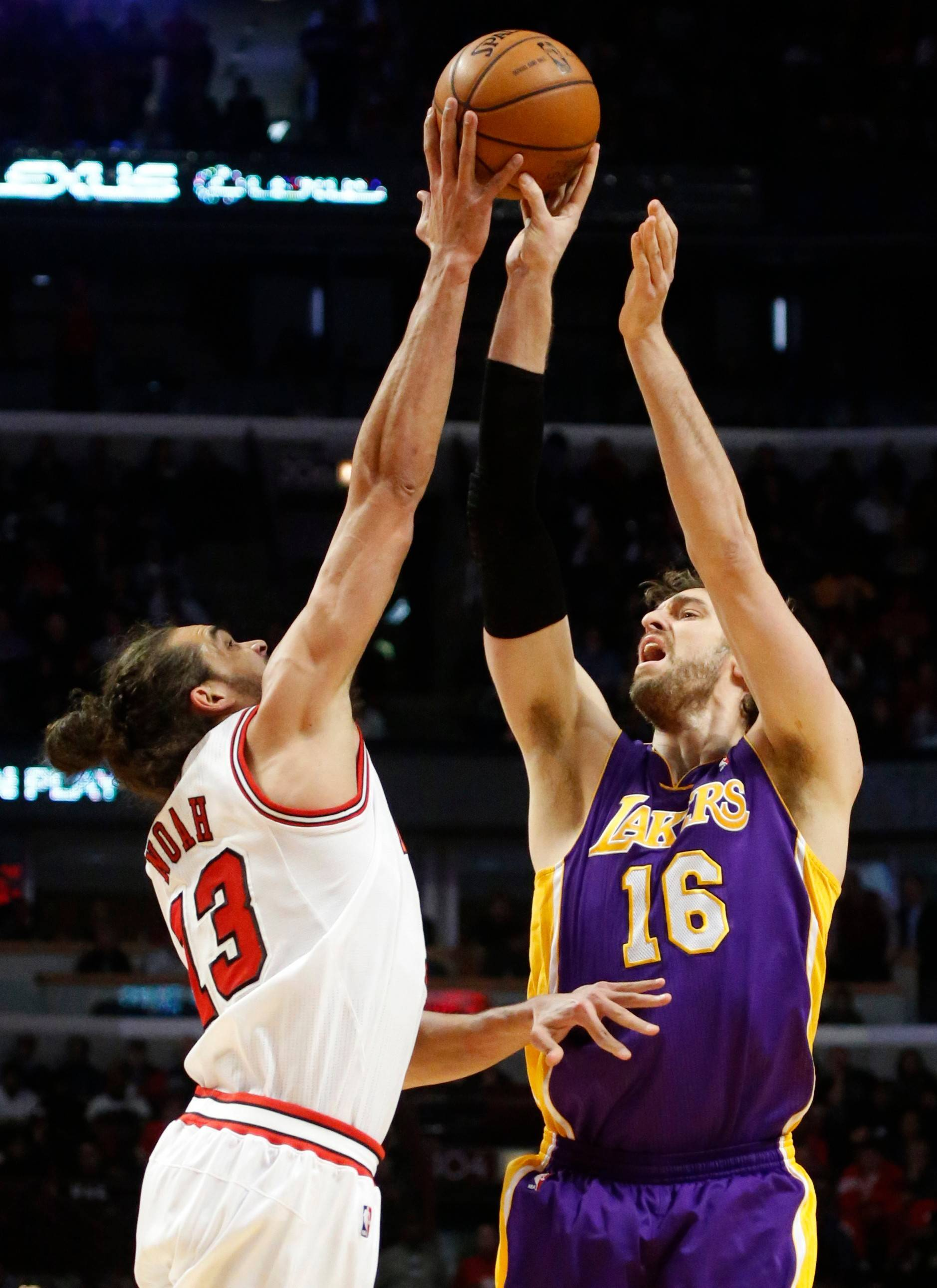 The Bulls' Joakim Noah blocks a shot from the Lakers' Pau Gasol. The Bulls plan to meet soon with Gasol, who is a free agent.