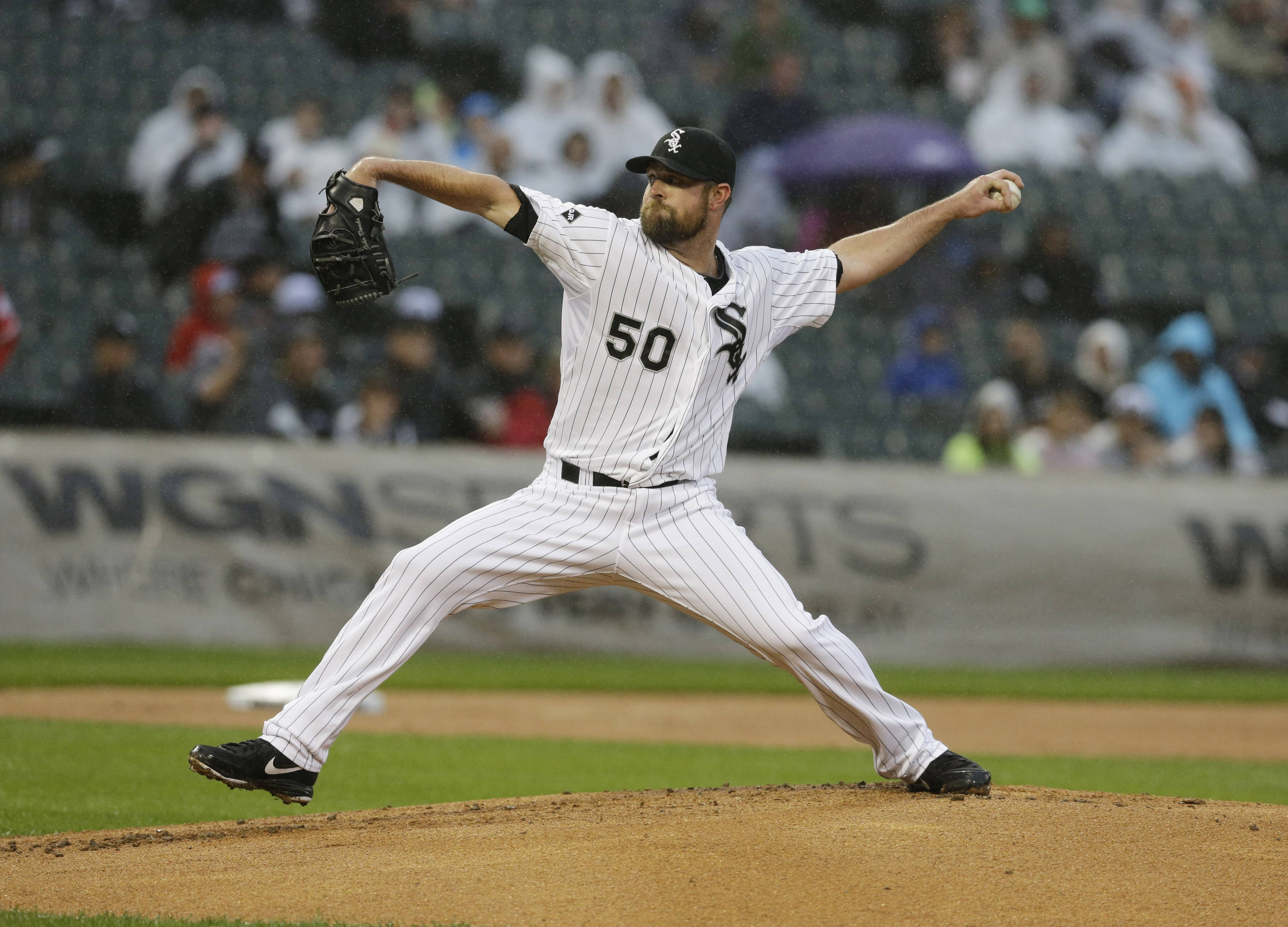 White Sox starter John Danks throws against the Los Angeles Angels during the first inning of a baseball game in Chicago on Wednesday, July 2, 2014.