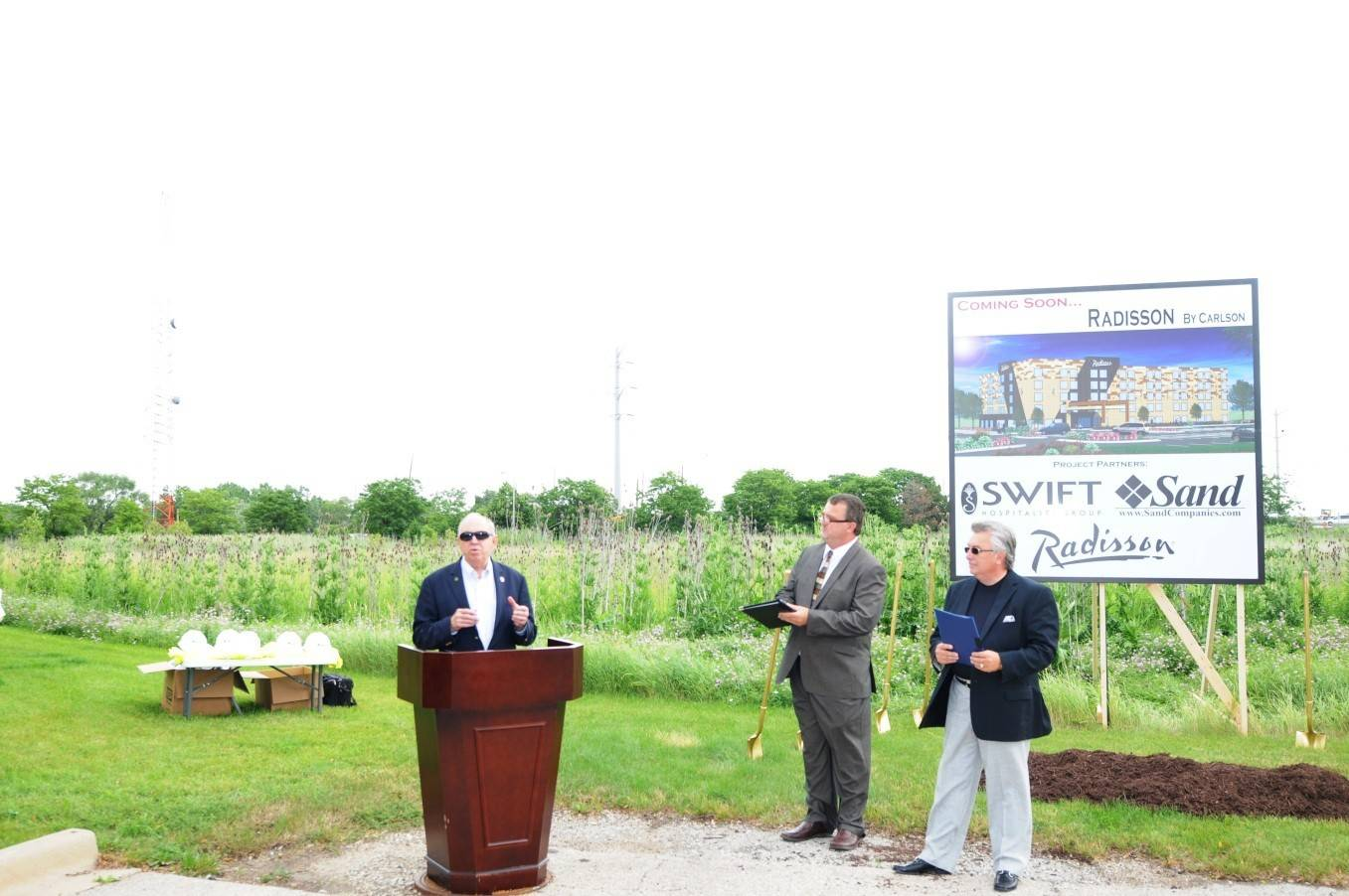 Schaumburg Mayor Al Larson, left, speaks during groundbreaking ceremonies this week for the new five-story, 142-room Radisson Hotel at the southwest corner of Roselle Road and the Jane Addams Memorial Tollway. With Larson are representatives of developers Swift Hospitality and Sand Companies.