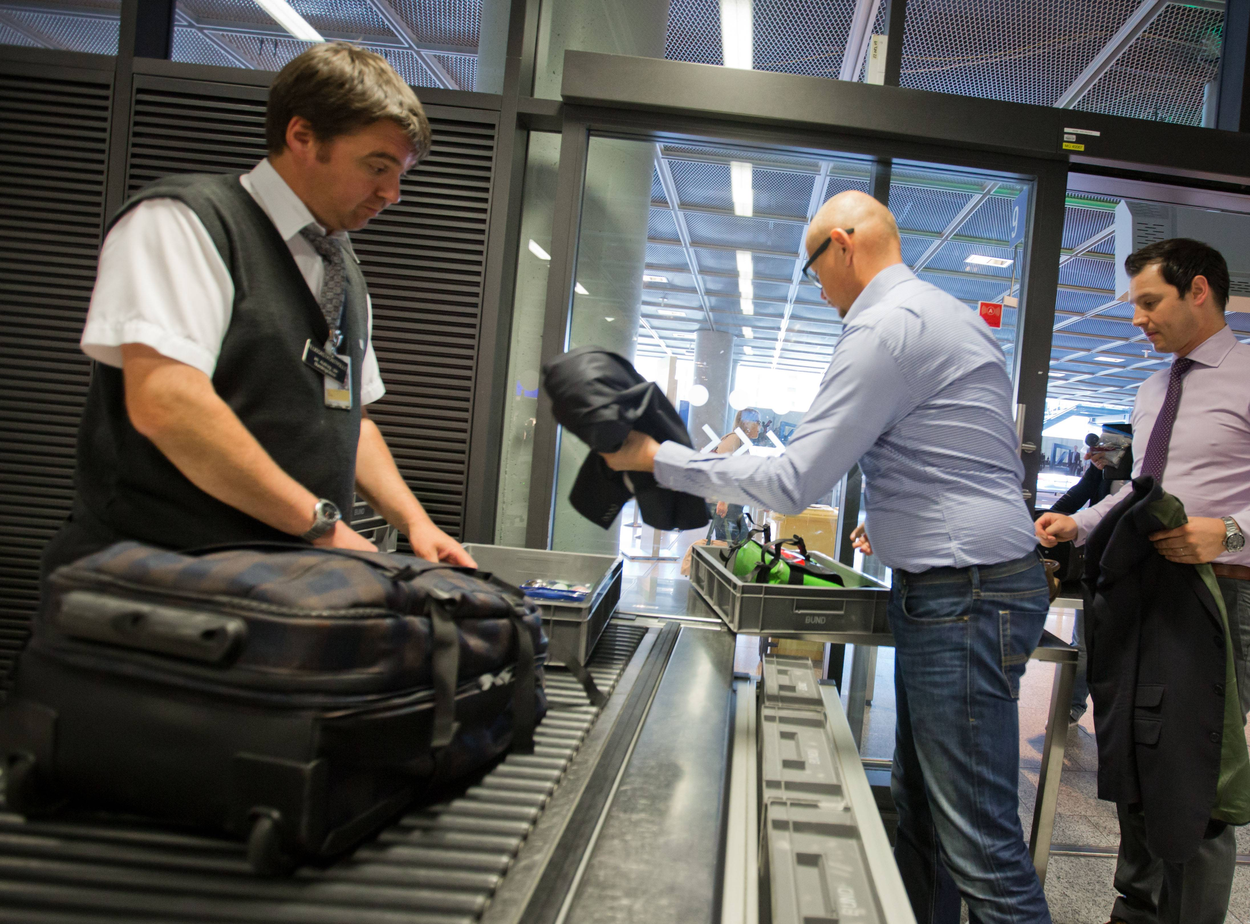 Passengers queue at the security checkpoint at the Rhein-Main airport in Frankfurt, Germany, Thursday. U.S. intelligence officials are concerned al-Qaida is trying to develop a new and improved bomb that could go undetected through airport security.