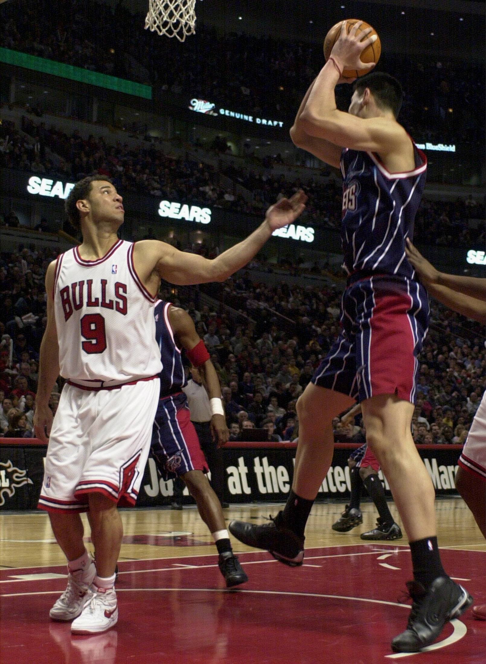 Former Chicago Bull Rick Brunson, left, shown here during a 2003 game against the Houston Rockets, was arrested last week in Vernon Hills on charges of attempted criminal sexual assault, criminal sexual abuse and aggravated battery, according to reports.