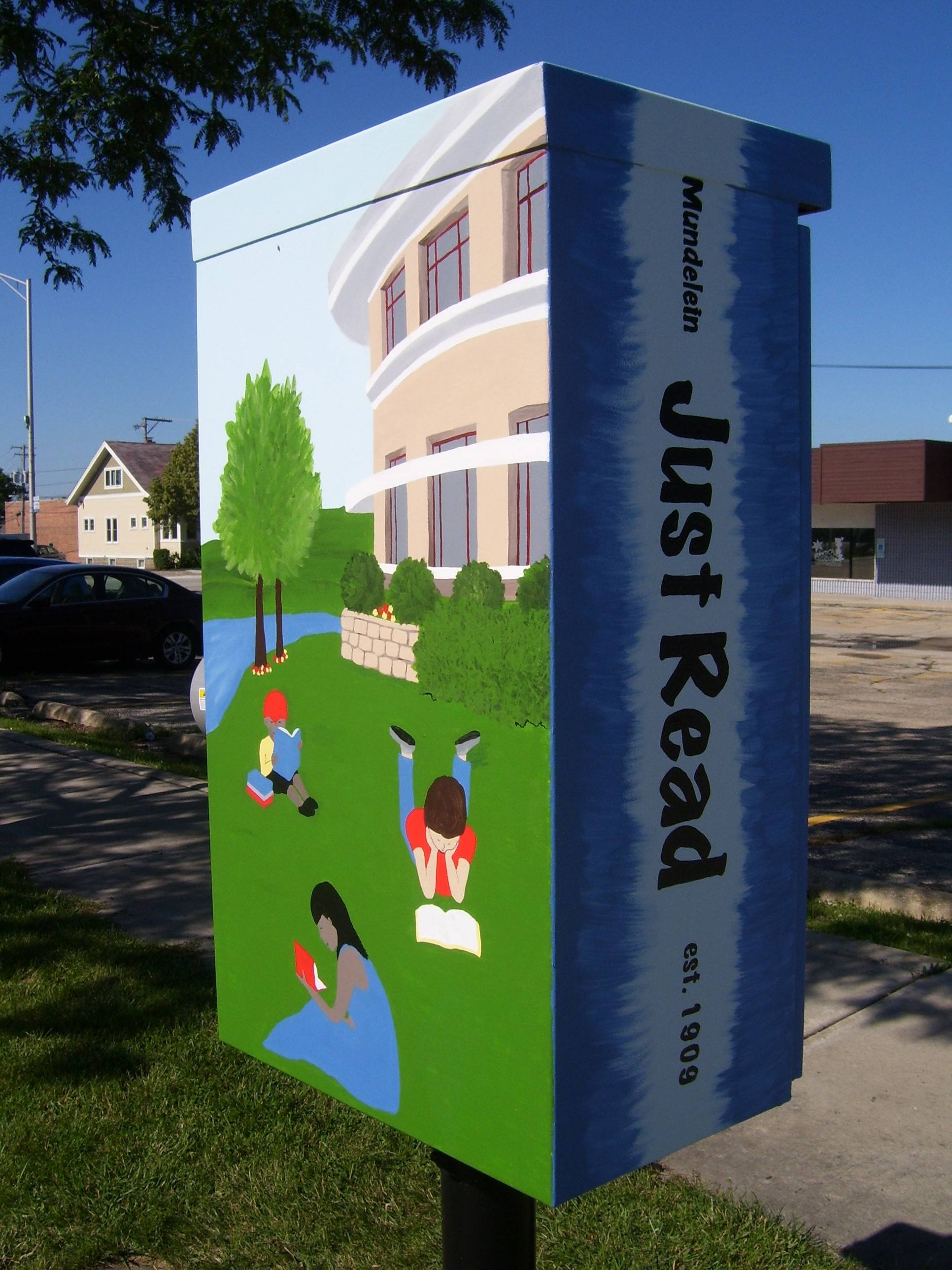 Artist Mary Hecht painted reading-themed images on a Mundelein utility box for a public art project. The project features three public utility boxes along Seymour Avenue painted by local artists.
