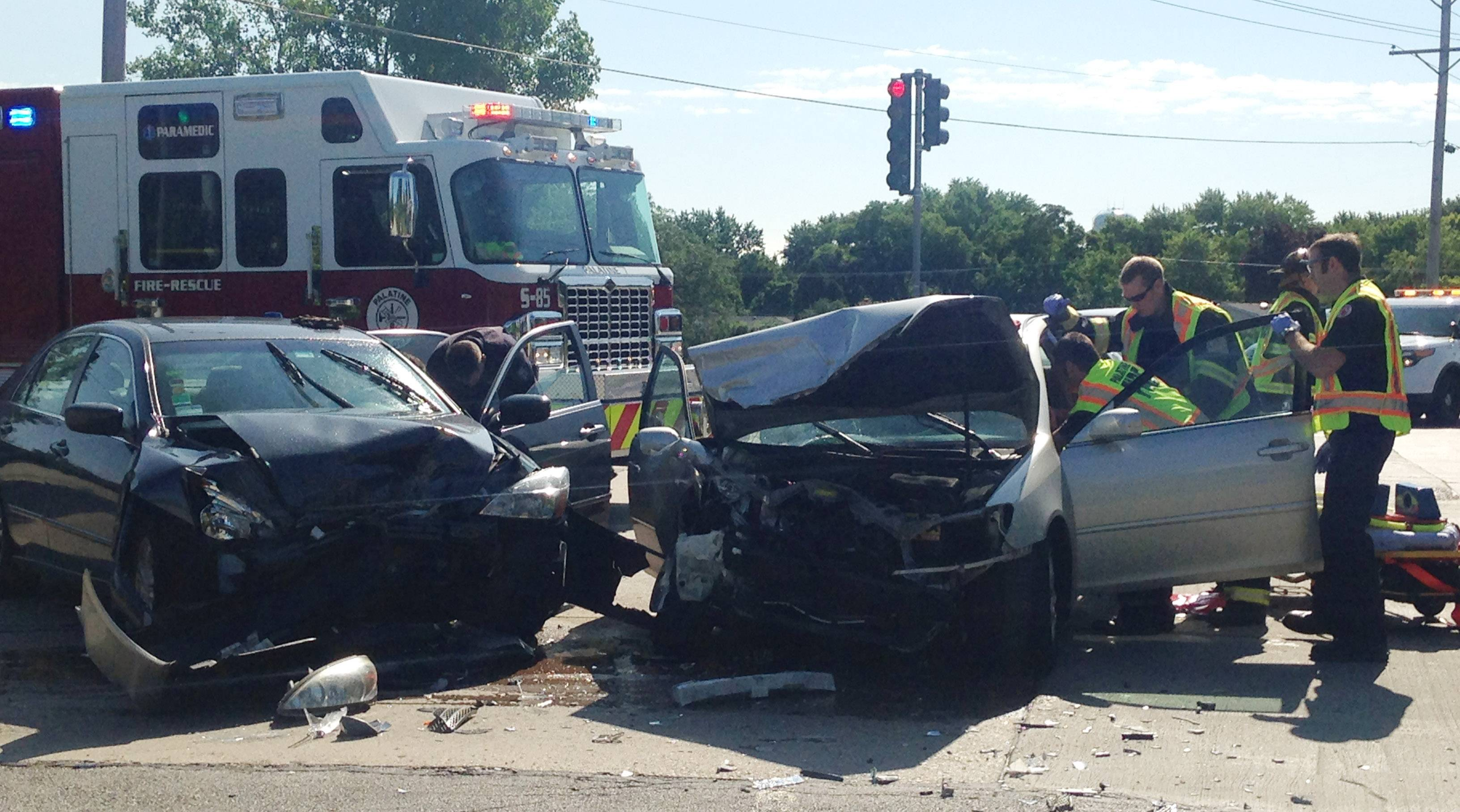 Emergency personnel respond to a two-car crash that took place in Palatine during the morning rush on Thursday.