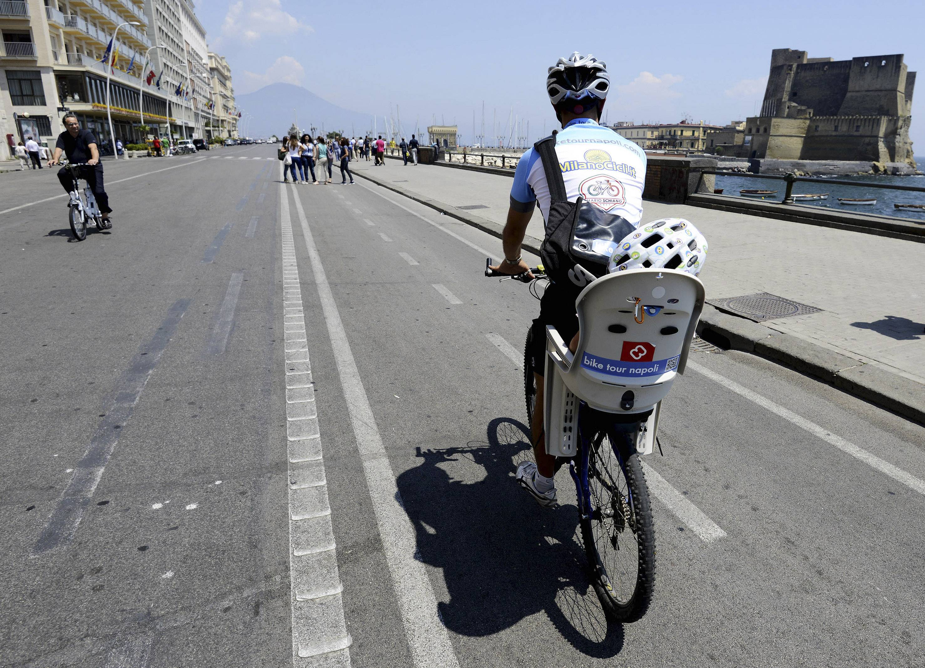 Luca Simeone pedals along a cyclists' path in Naples, Italy.