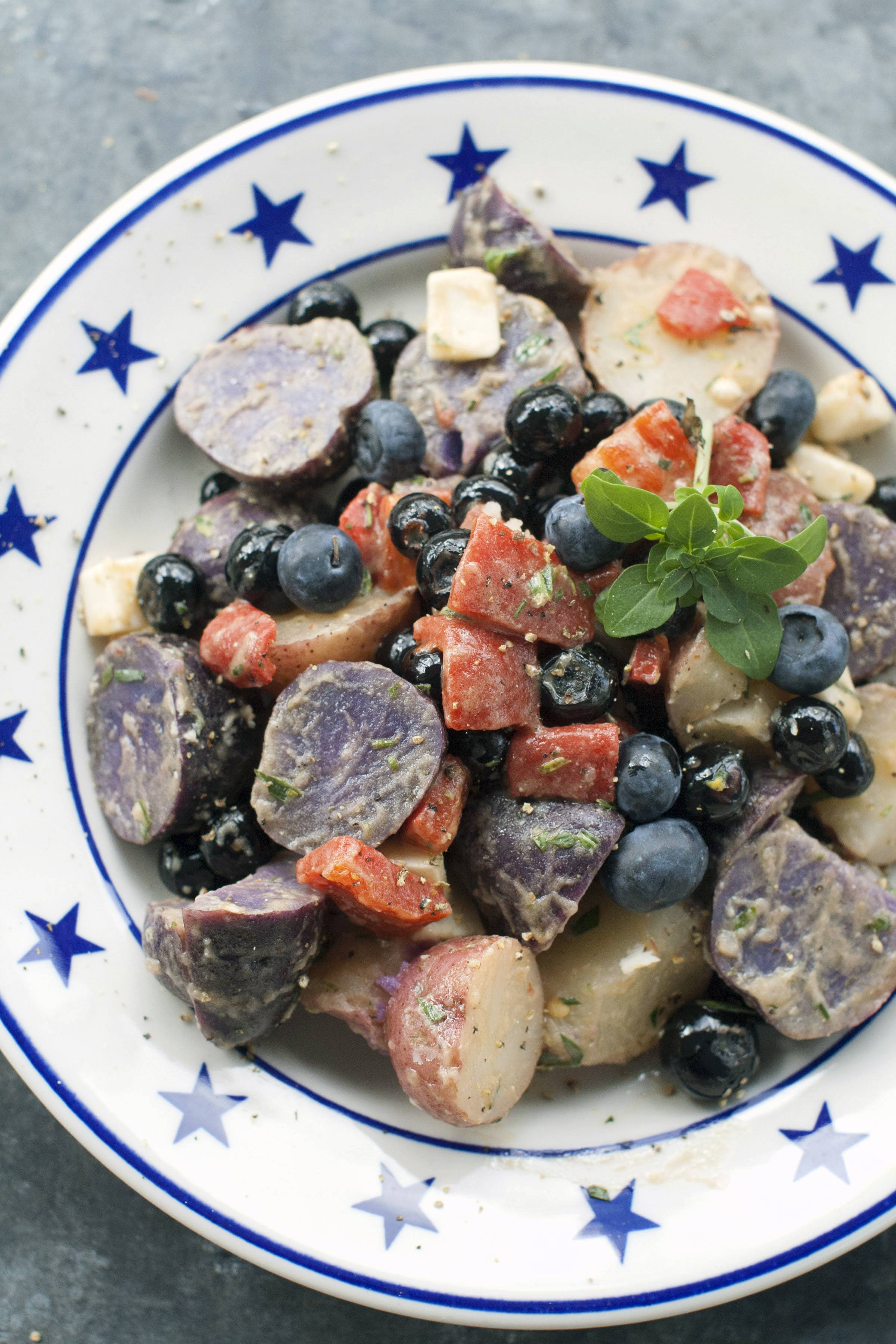 Red and purple potatoes, roasted red peppers, cubes of white goat cheese and several cups of blueberries provide patriotic colors that reflect the spirit of the Fourth of July holiday.