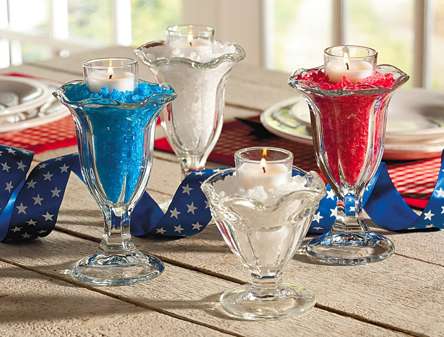 Fill old-fashioned ice cream glasses with Americana-colored rock candy to craft sweet bases for votives.