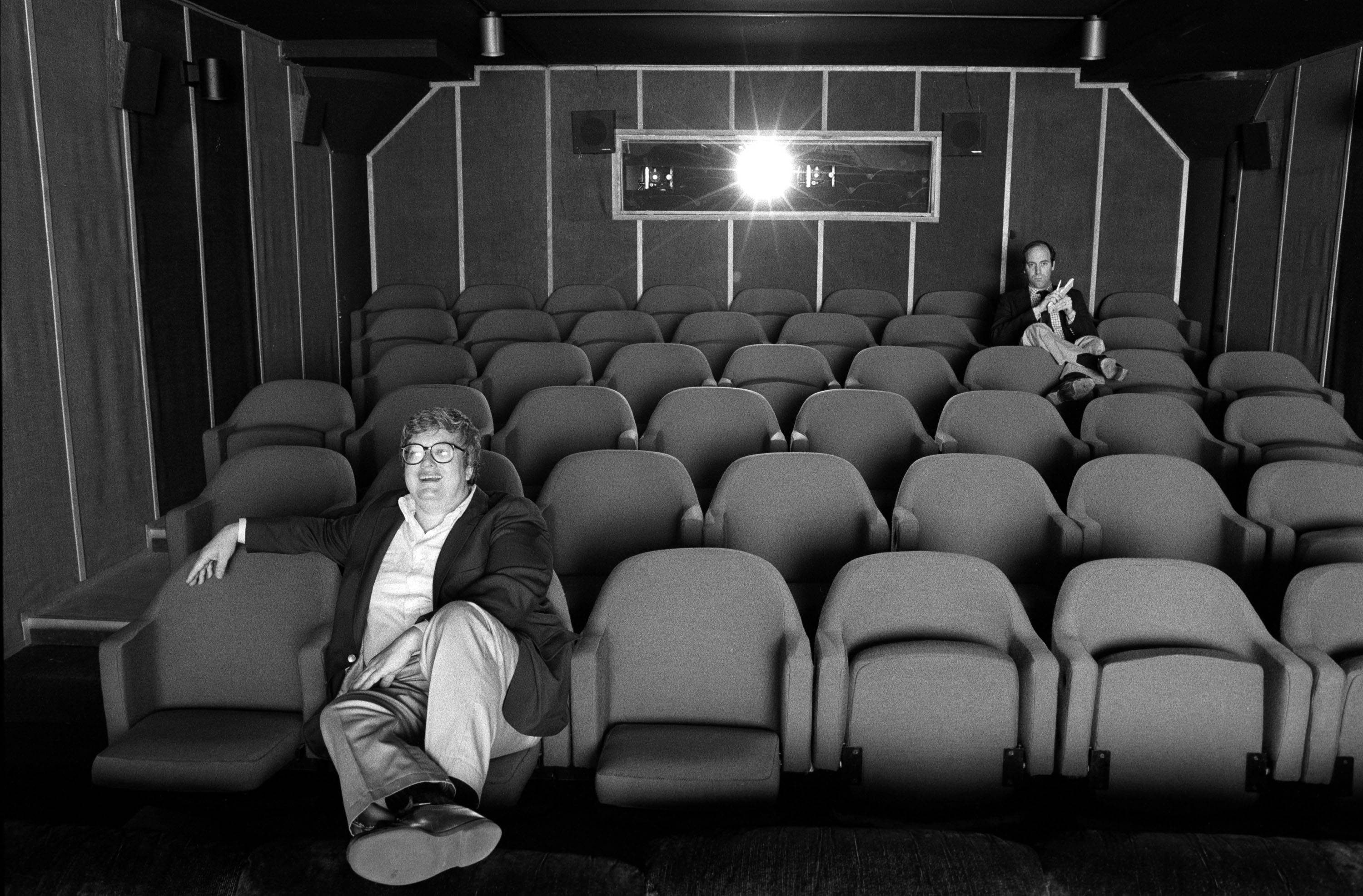 "Chicago film critic Roger Ebert enjoys a movie during Steve James' excellent documentary ""Life Itself."""